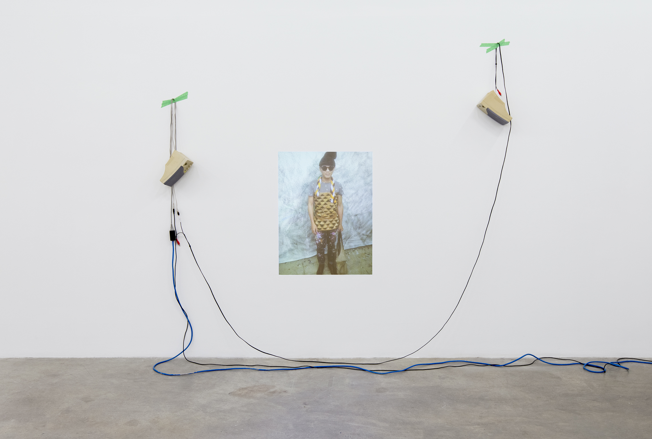 Ron Tran, Blue, Head, Red, Toes, and Green (unintentional moments), 2009–ongoing, HDV projection (photographs captured by friends), sound, 5 minutes, 28 seconds by