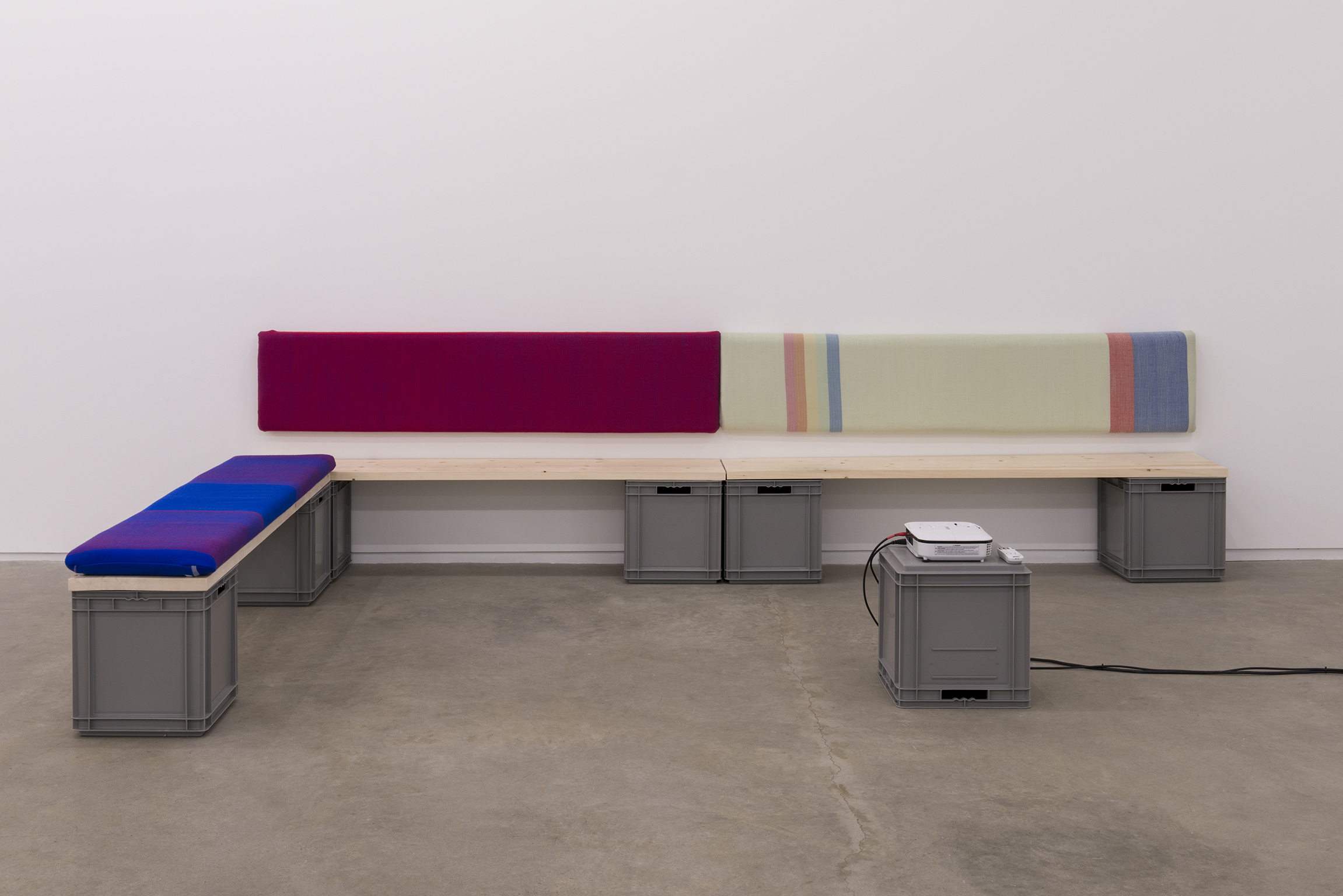 Andrea Büttner, Benches, 2013, handwoven wool backrests, spruce, plastic crates, each 37 x 78 x 16 in. (93 x 2 x 40 cm) by