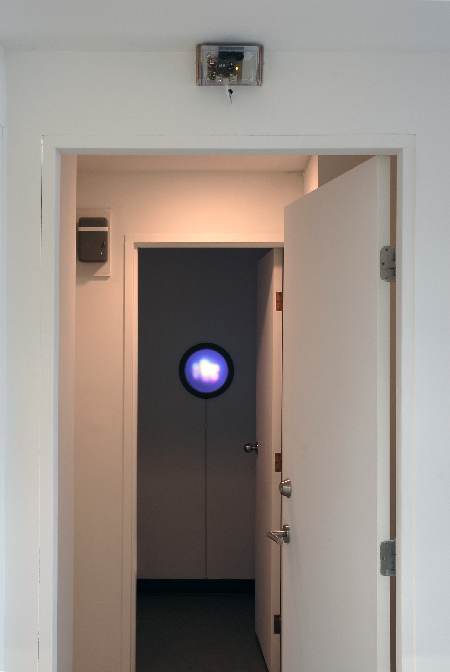 Germaine Koh, Volume (Traffic), 2008, modified household fixture with LEDs responding to traffic conditions, 13 × 13 × 5 in. (33 x 33 x 13 cm) by