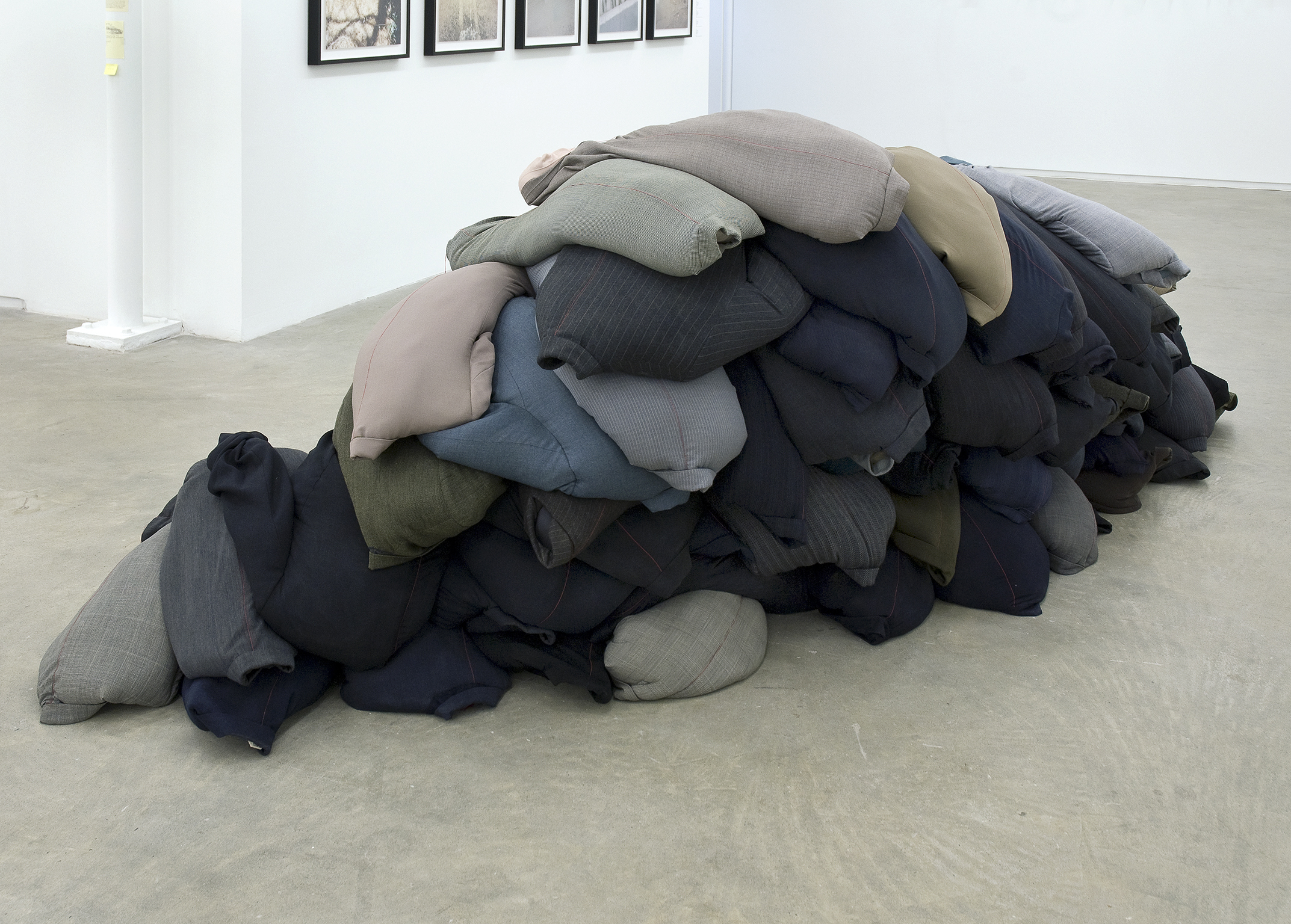 Rebecca Belmore, Thin Red Line, 2009, suit jackets, sand, dimensions variable by