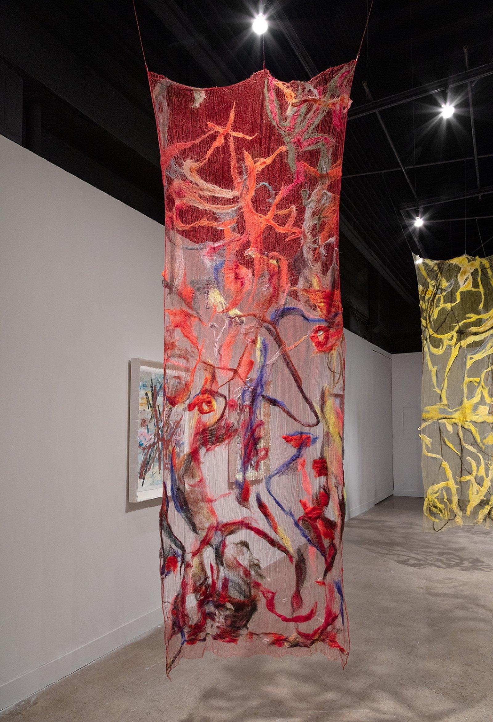 Rebecca Brewer, Scrim: Tweaker, 2019, silk, wool, ball chain, alligator clips, hooks, 103 x 39 in. (262 x 99 cm). Installation view, Waves and Waves, Oakville Galleries, Oakville, 2019