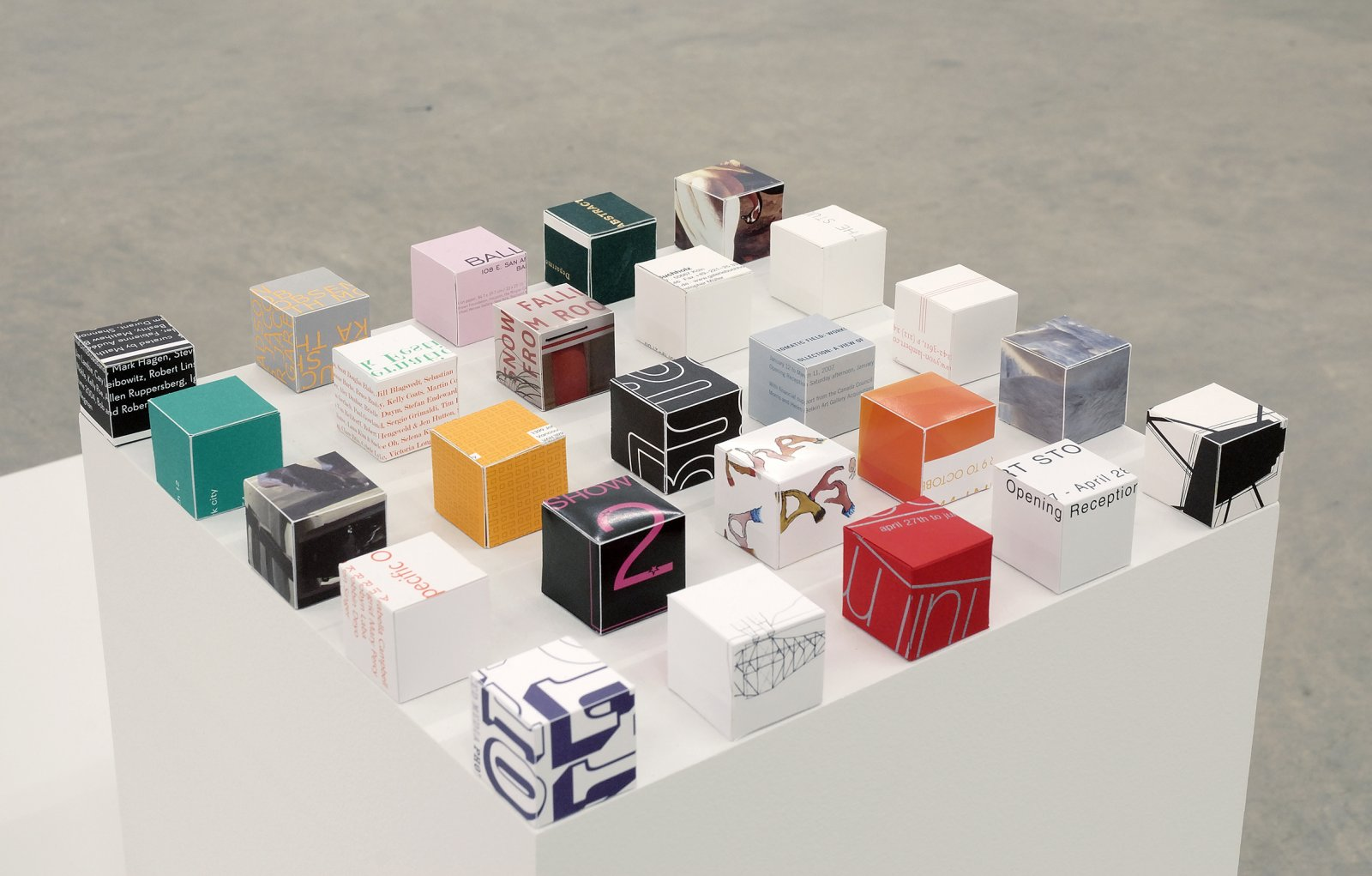 ​Arabella Campbell, 25 Cubes on a Square (for/form/from Sol Lewitt), 2002–2007, cut-up exhibition invitations, plinth, 12 x 12 x 12 in. (31 x 31 x 31 cm) by