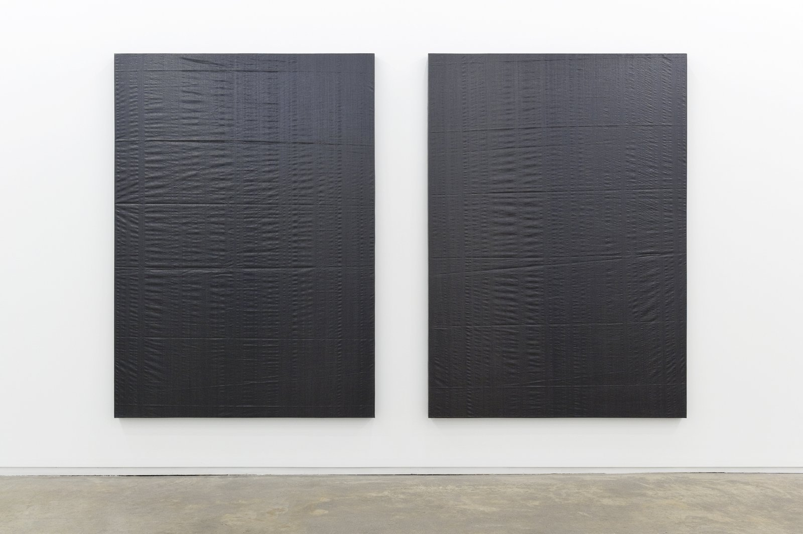 ​Arabella Campbell, Triptych, 2011, 2 grey plastic tarps, one wall, 84 x 133 in. (213 x 337 cm) by