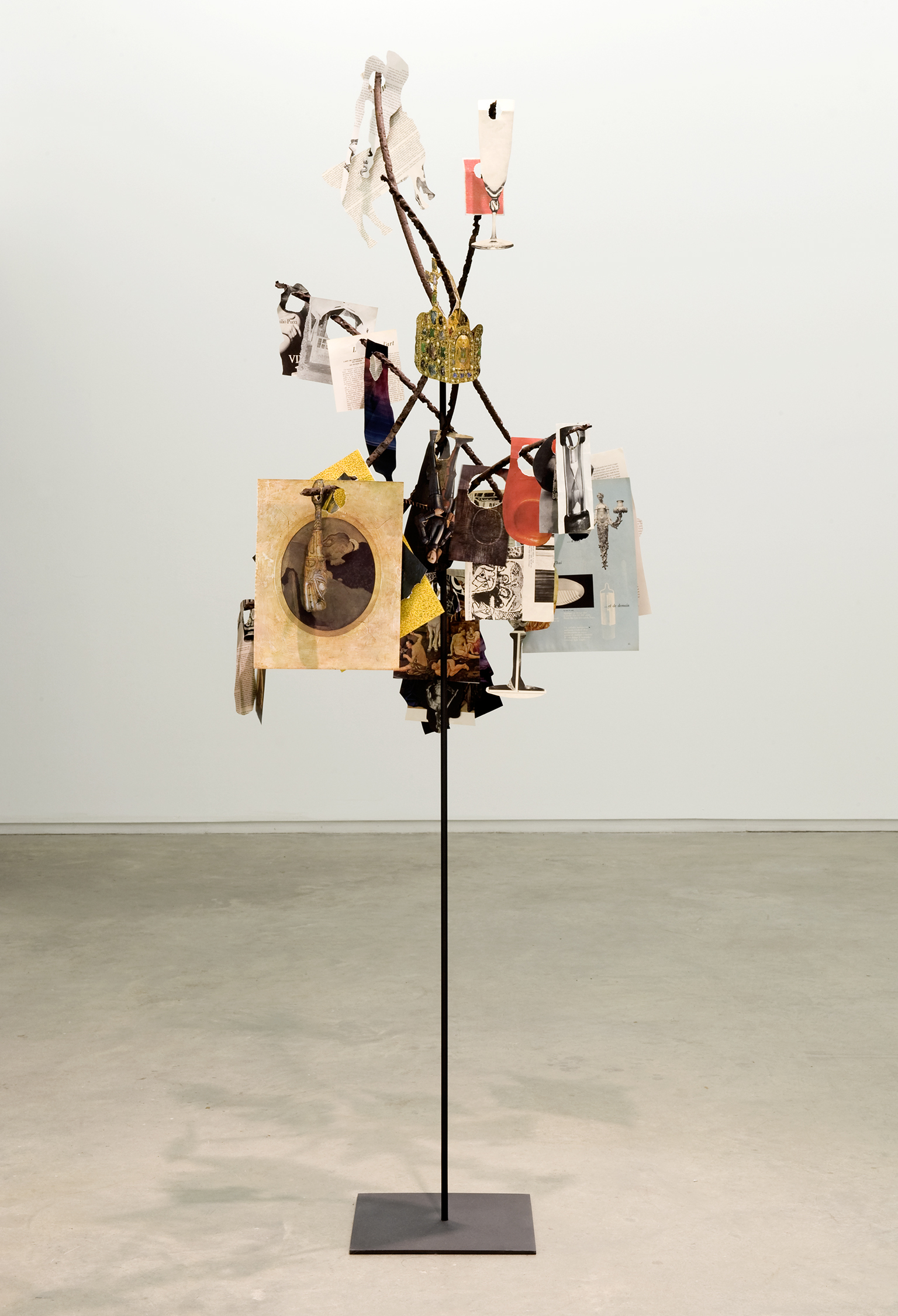 Geoffrey Farmer, Metal Will Stand Tall (A Single Image Is Not A Splendor), 2011, found metal, book cut outs, metal box, musical instruments, dimensions variable by