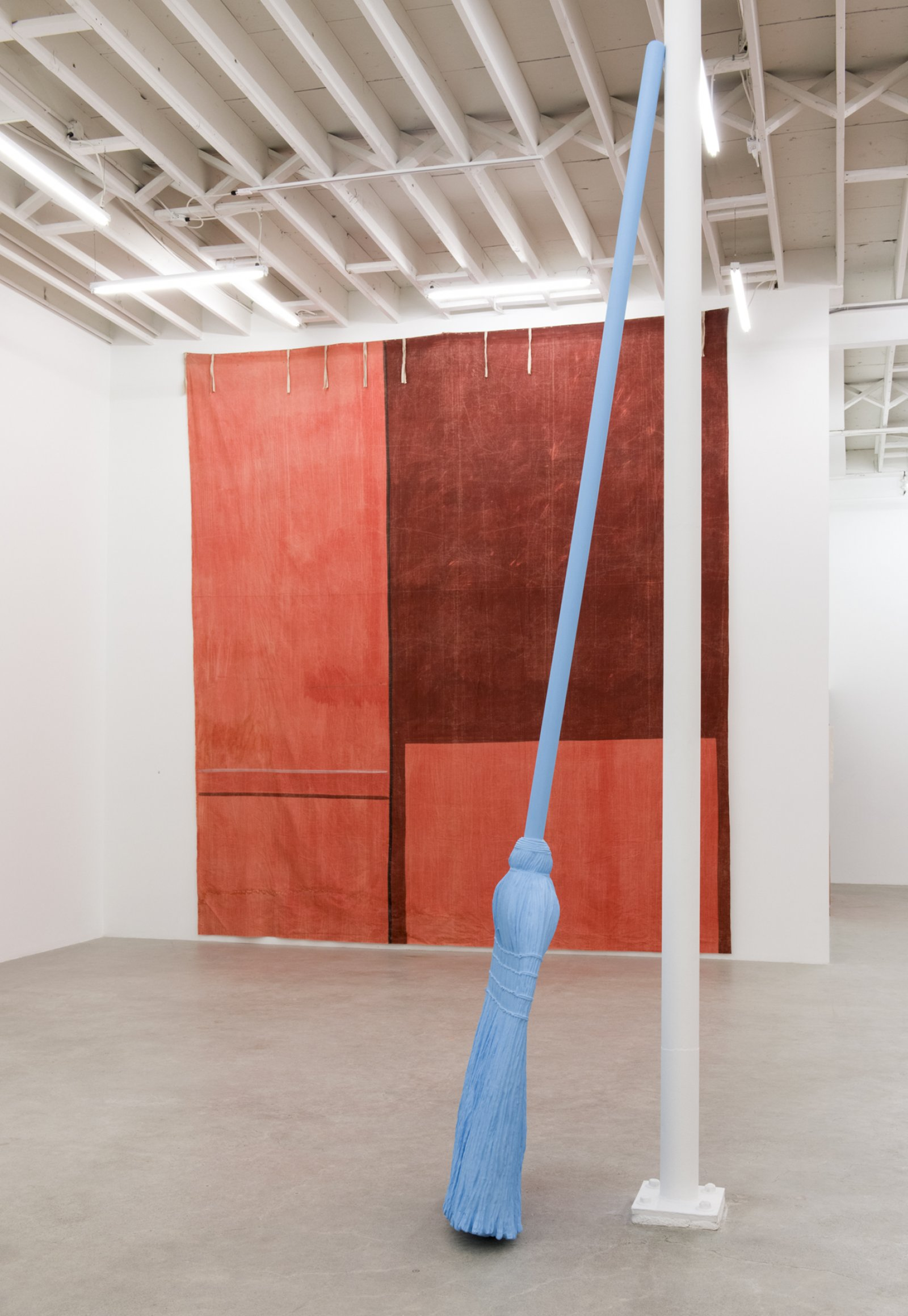 Geoffrey Farmer, ATTUNED FULL MOON BROOM WITH TALL WALL SCRAWL, 2017, theatre backdrop (1939), foam, plastic, paint, backdrop: 183 x 163 in. (464 x 414 cm), broom: 148 x 26 x 9 in. (375 x 65 x 23 cm)
