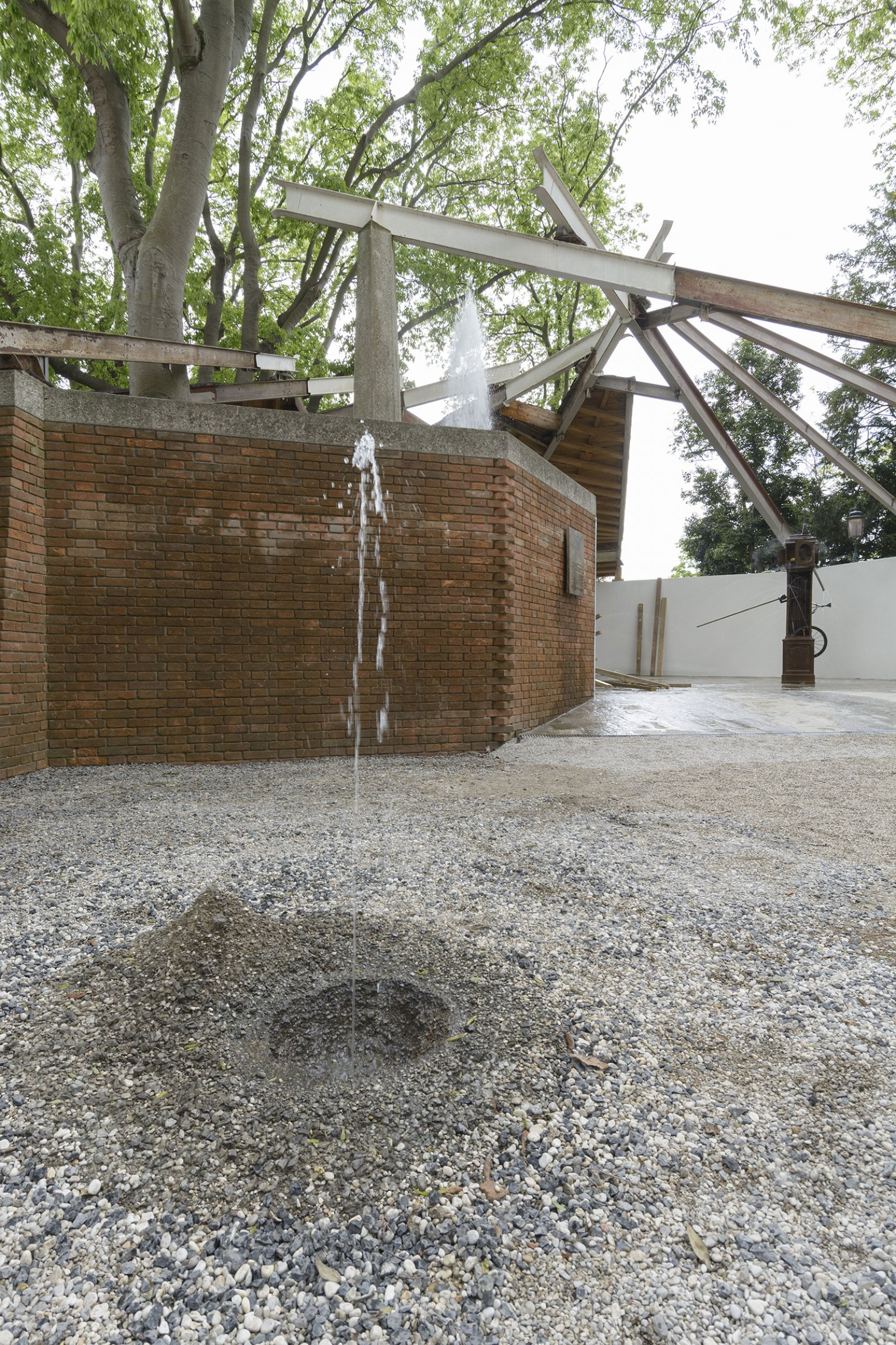 Geoffrey Farmer, Drinking Fountain, 2017, tombak cast of a hole in the ground, sensor, water technics, 12 x 63 x 55 in. (30 x 160 x 140 cm). Installation view, A way out of the mirror, Canada Pavilion, 57th Venice Biennale, Venice, Italy