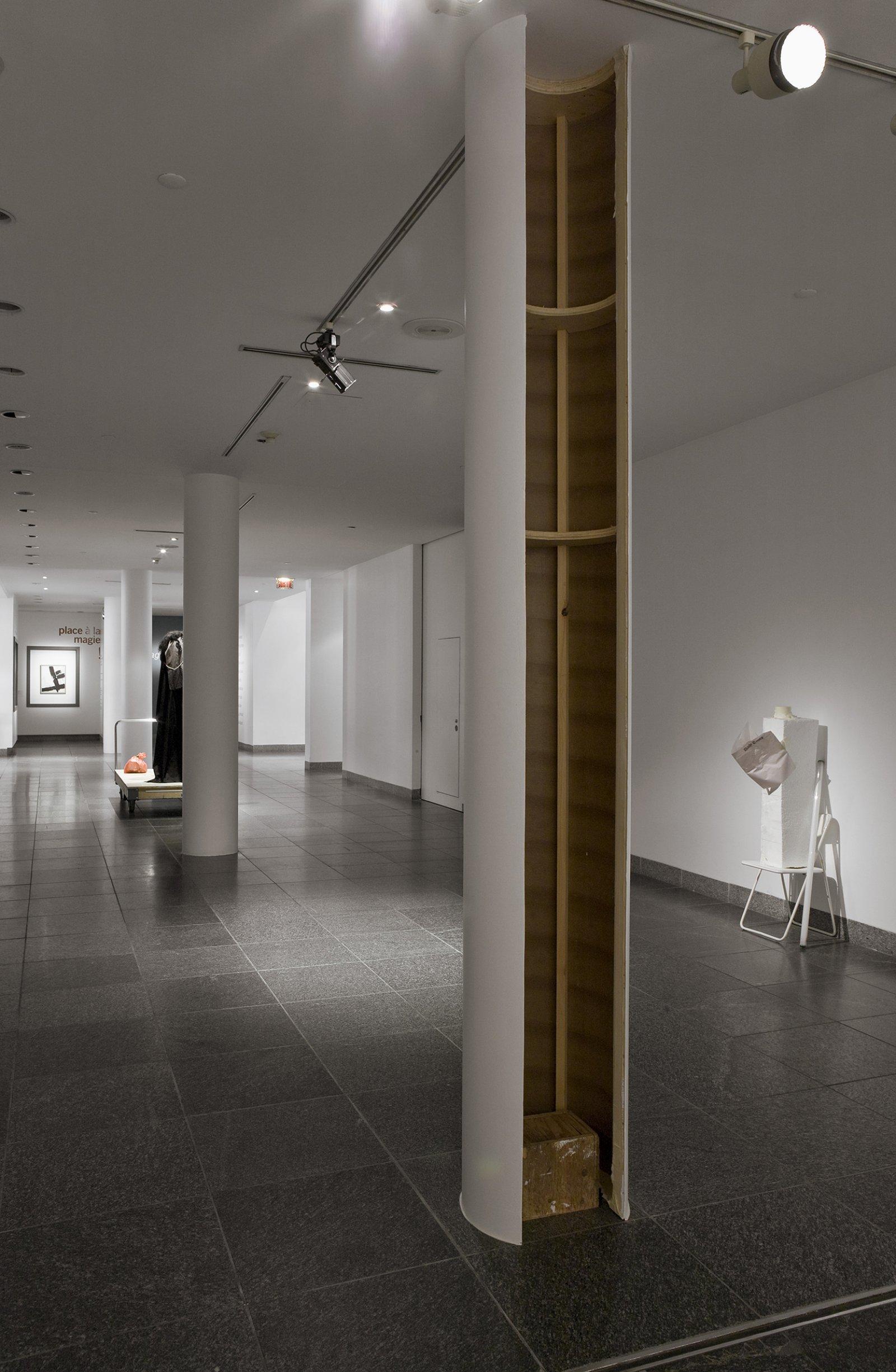 Geoffrey Farmer, Ghost Face, 2008, cardboard form, wood, cotton, glue, eyes cut out of post, standing shelf, 157 x 20 x 20 in. (398 x 50 x 50 cm) by Geoffrey Farmer