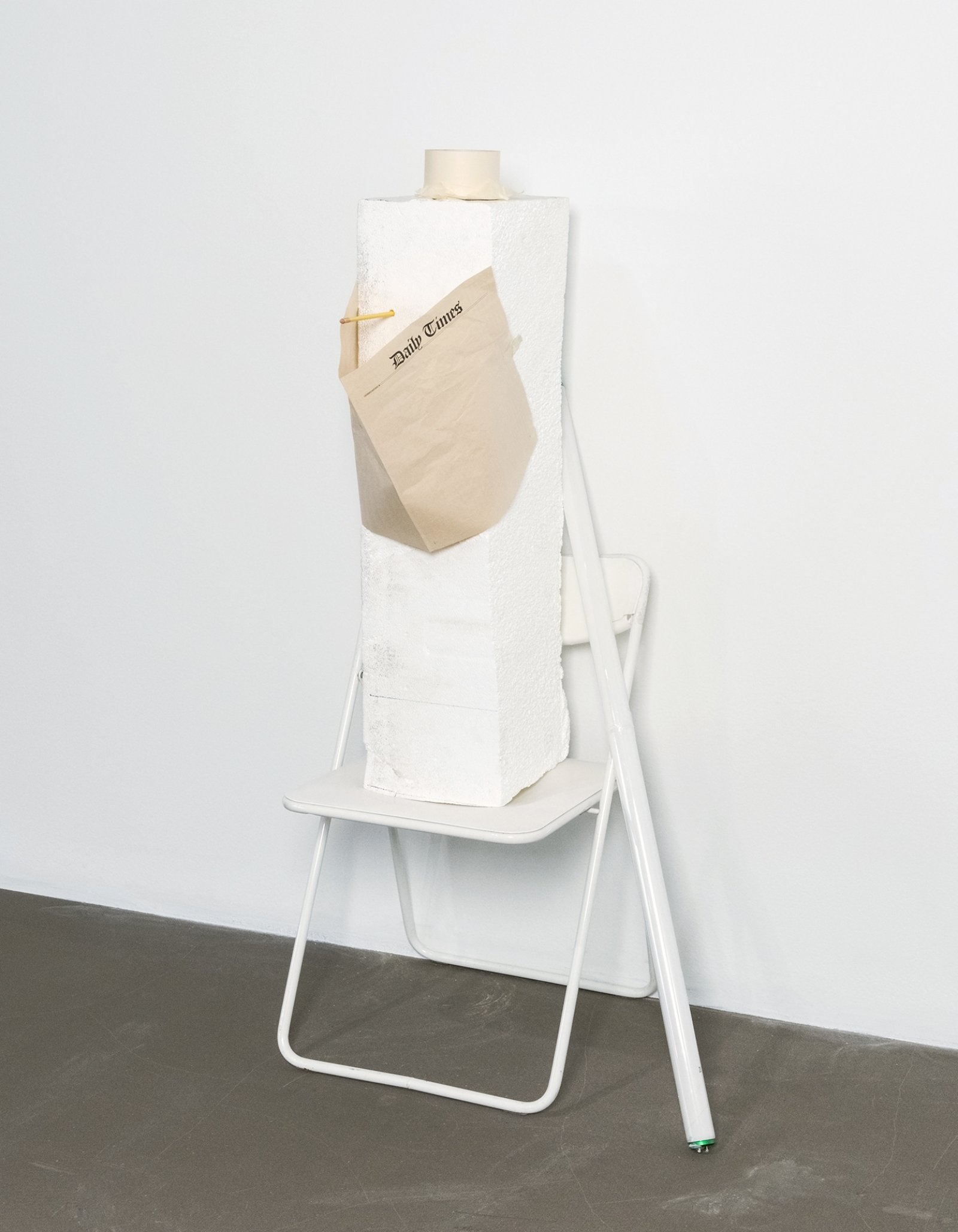 Geoffrey Farmer,Iam by nature one and also many, dividing the single me into many, and even opposing them as great and small, light and dark, and in ten thousand other ways (I know what it is like to fall), 2006–2008,white chair, styrofoam, newspaper, tape, pencil, fluorescent bulb, 58 x 21 x 18in. (147 x 53 x 46 cm)