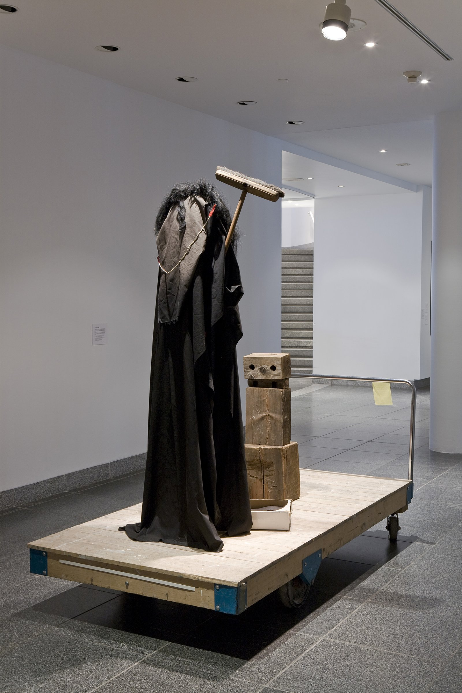 Geoffrey Farmer, I am by nature one and also many, dividing the single me into many, and even opposing them as great and small, light and dark, and in ten thousand other ways, 2006–2008, wood, fabric, broom, wig, dimensions variable by Geoffrey Farmer