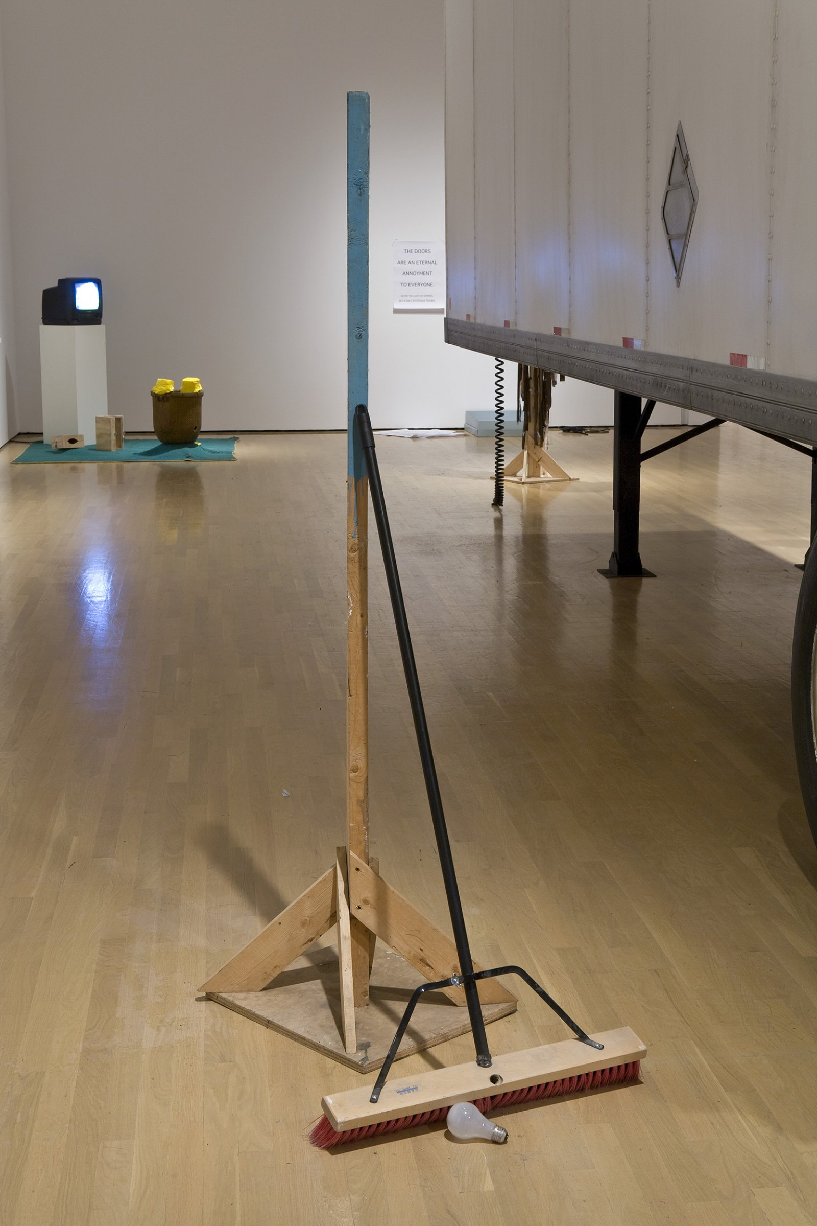 Geoffrey Farmer, I am by nature one and also many, dividing the single me into many, and even opposing them as great and small, light and dark, and in ten thousand other ways, 2006–2008, wooden post, broom, lightbulb, dimensions variable by Geoffrey Farmer