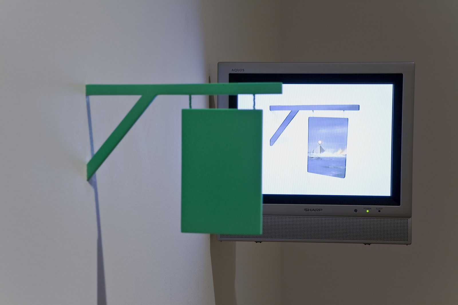 Geoffrey Farmer, I thought that I could make a machine that would pierce the fabric of reality, in your world it appears as a 16th-century sign, 2004, DVD , monitor, sculpture dimensions variable