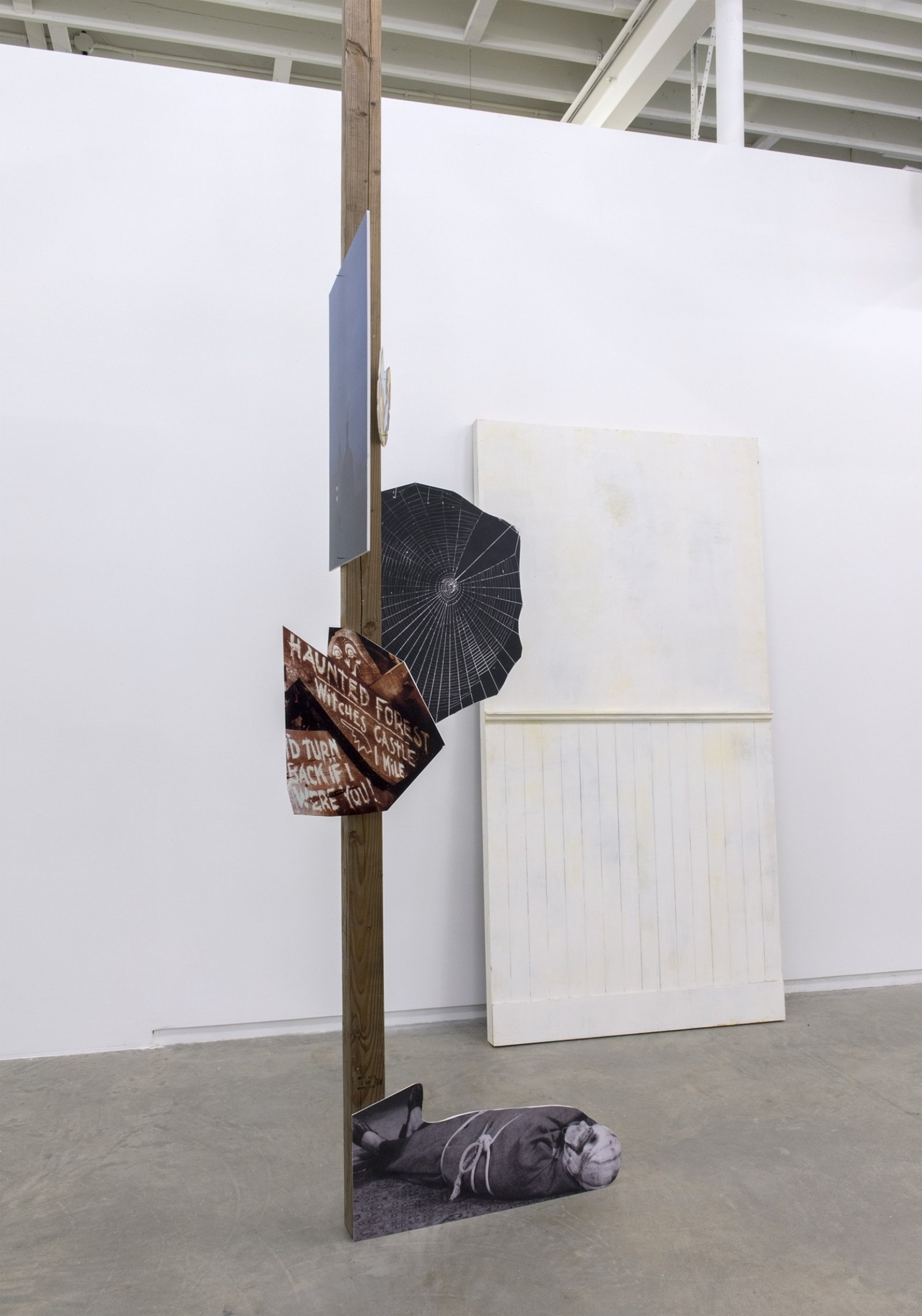 Geoffrey Farmer, I'd turn back if I were you., 2014, douglas fir pole, 8 photographs mounted on foamcore, wooden wall façade, pole: 200 x 4 x 4 in. (508 x 9 x 9 cm), wall façade: 90 x 71 in. (229 x 181 cm) by Geoffrey Farmer