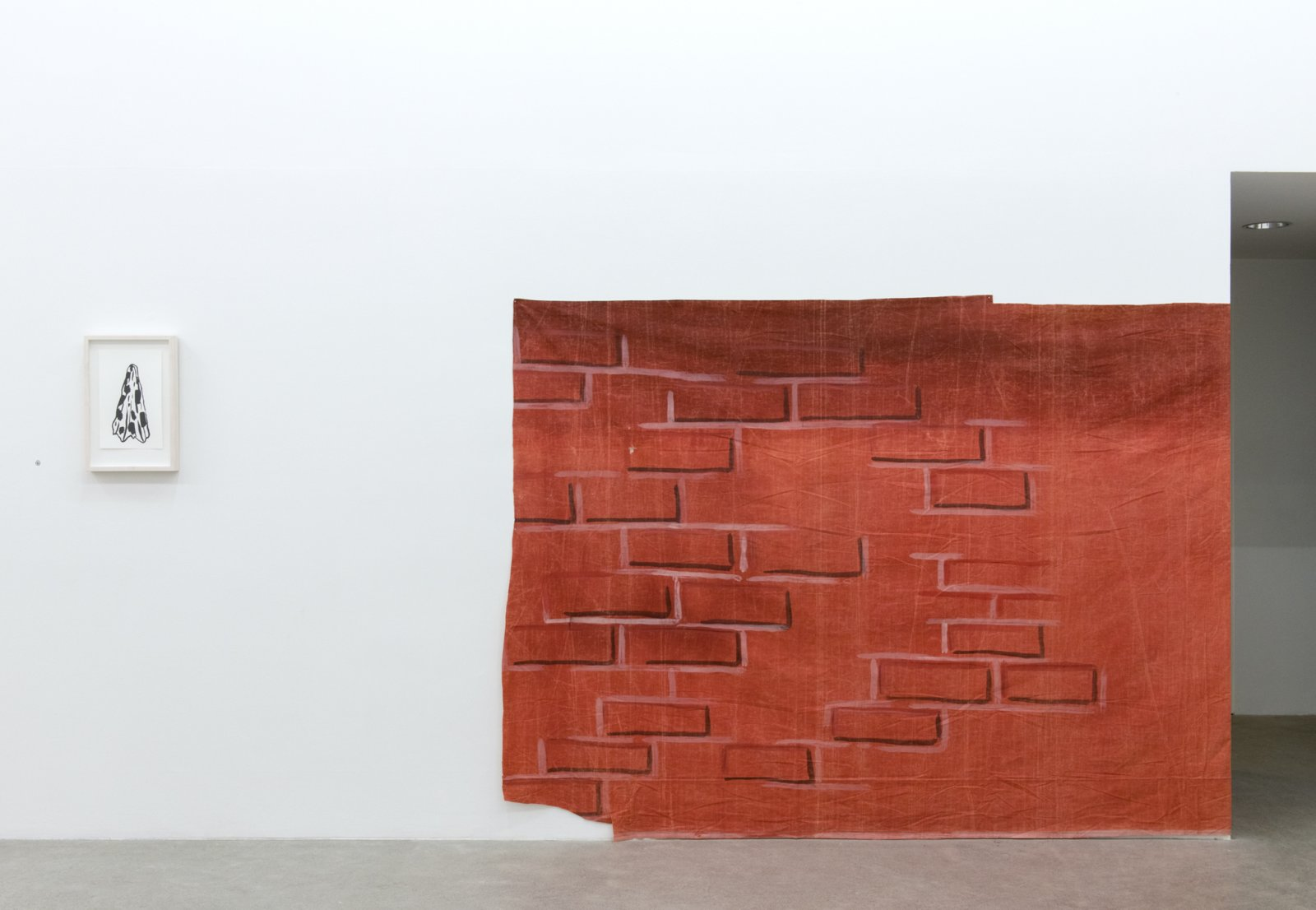 Geoffrey Farmer, LIPSTICK BRICK WITH MID VOWEL AFOUL DISH TOWEL, 2017, ink on paper, theatre backdrop (1939), backdrop: 71 x 200 in (180 x 508 cm), drawing: 18 x 12 in. (45 x 30 cm)