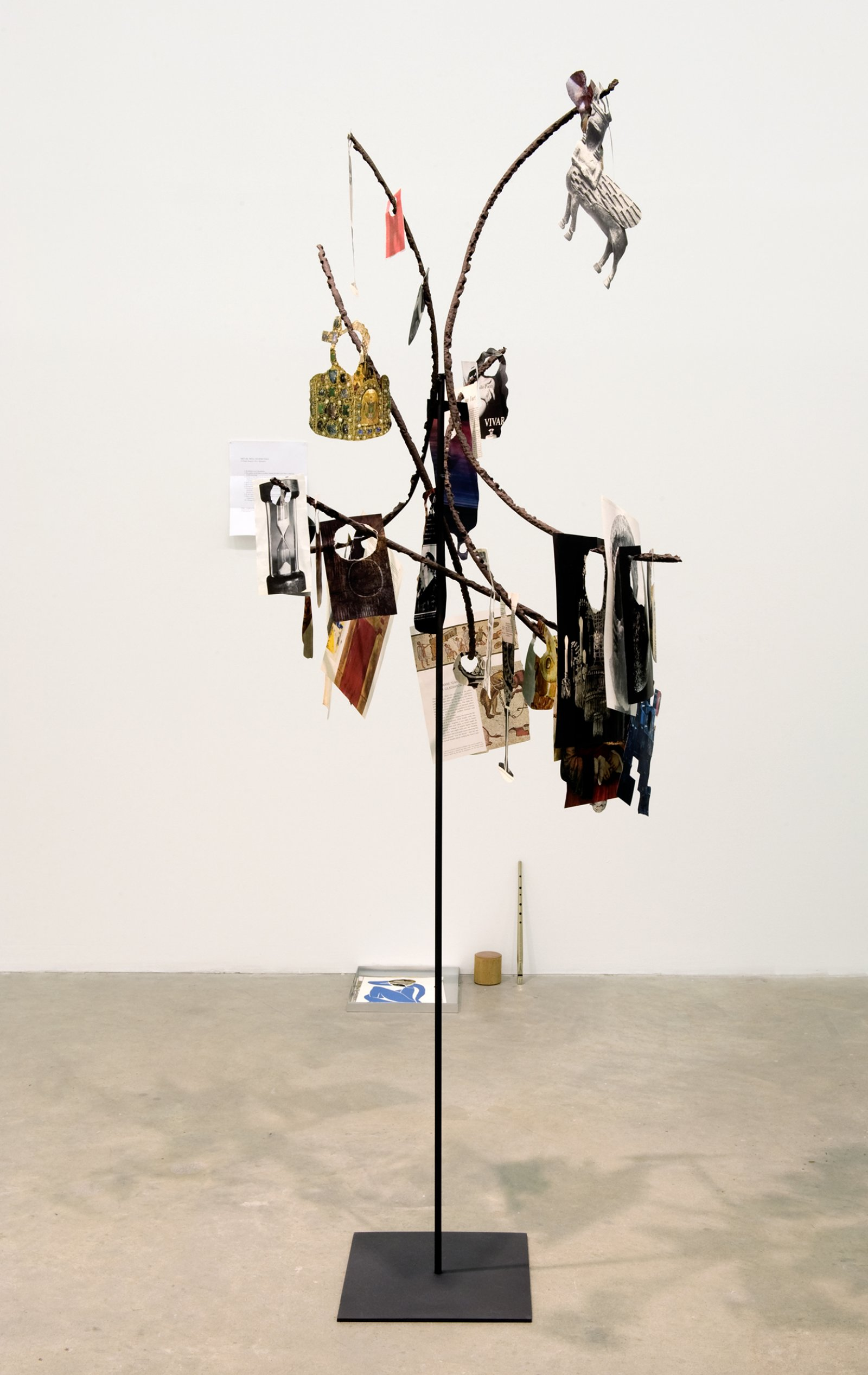 Geoffrey Farmer,Metal Will Stand Tall (A Single Image Is Not A Splendor), 2011–2012, found metal,LIFE Magazinecutouts, rock, wire, 69 x 39 x 28 in. (175 x 99 x 71 cm)