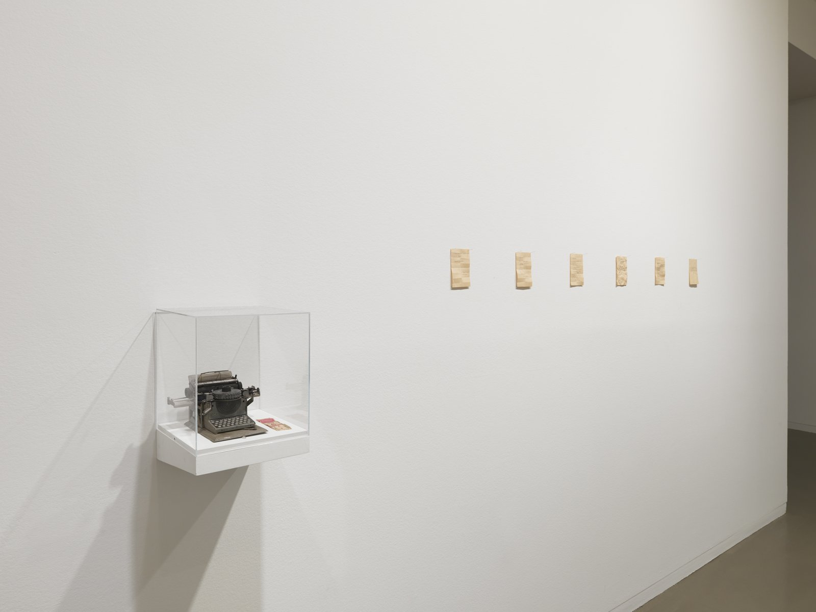 Geoffrey Farmer, Notes For Strangers, 1989–1990, small typewriter, 6 typewritten notes on paper, transfer ticket, shelf with plexiglass top, dimensions variable by Geoffrey Farmer