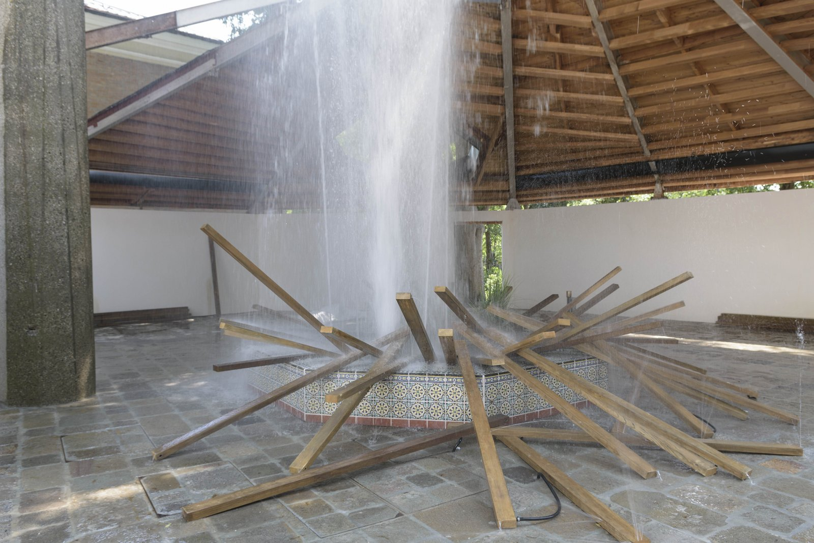 Geoffrey Farmer, SFAI Fountain, 2017, resin structure covered by ceramic tiles, artificial plants, acid-etched brass, waterworks, 150 x 150 x 19 in. (381 x 381 x 47 cm). Installation view, A way out of the mirror, Canada Pavilion, 57th Venice Biennale, Venice, Italy