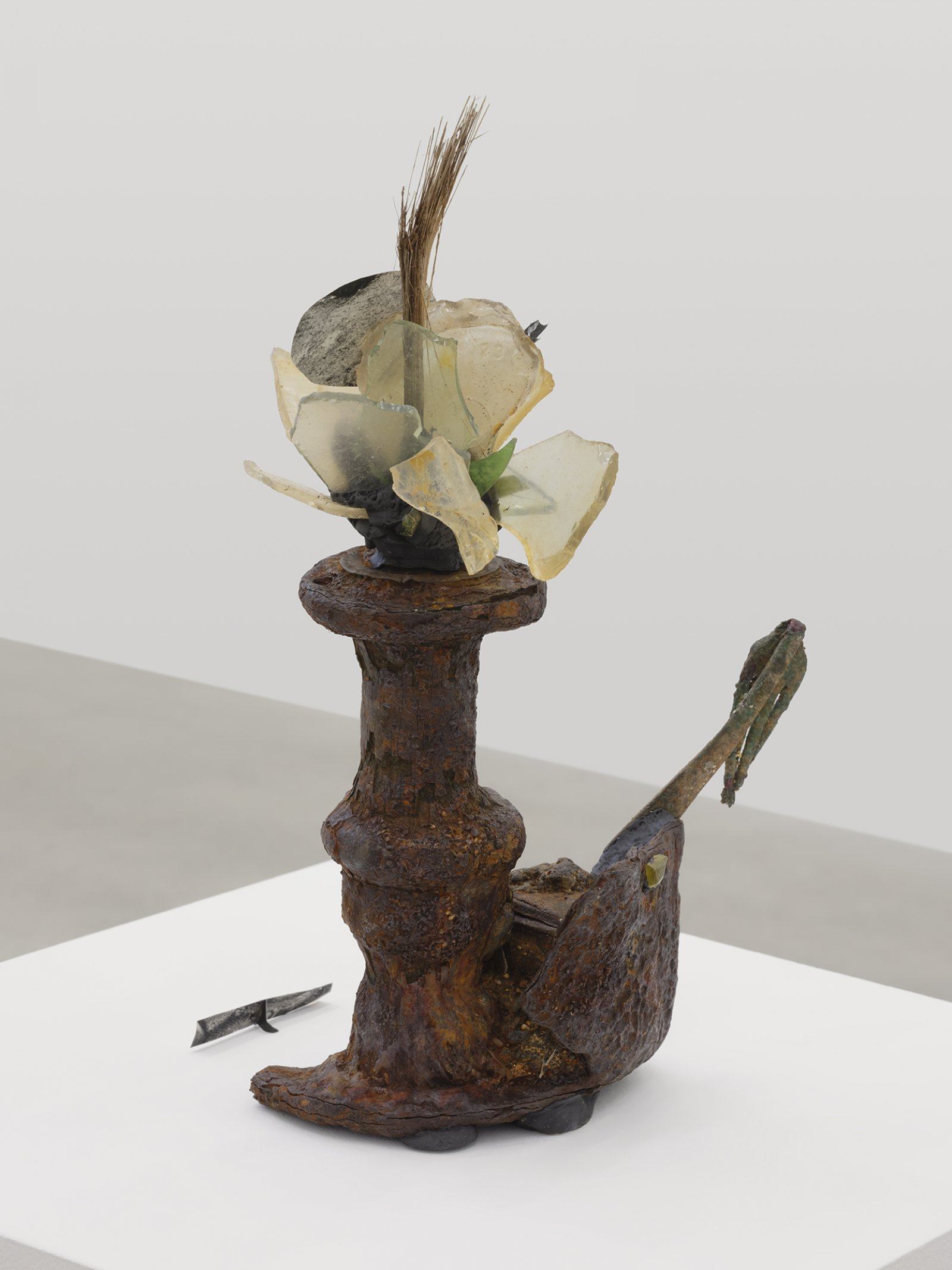 Geoffrey Farmer, Seven Pounds of Red Meat, 2019, metal, glass, coconut, paper, 14 x 9 x 6 in. (36 x 23 x 15 cm)