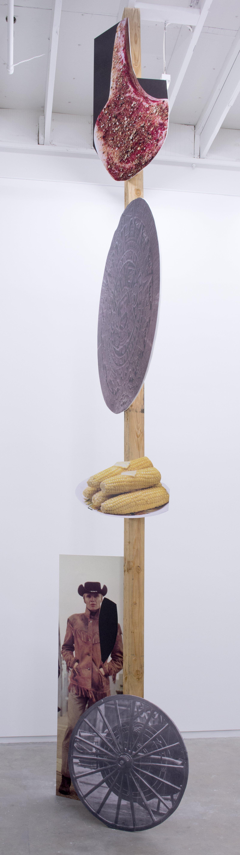 Geoffrey Farmer,Some kinds of sacrifice, 2014, douglas fir pole, 6 photographs mounted on foamcore, 200 x 4 x 4 in. (508 x 9 x 9 cm)
