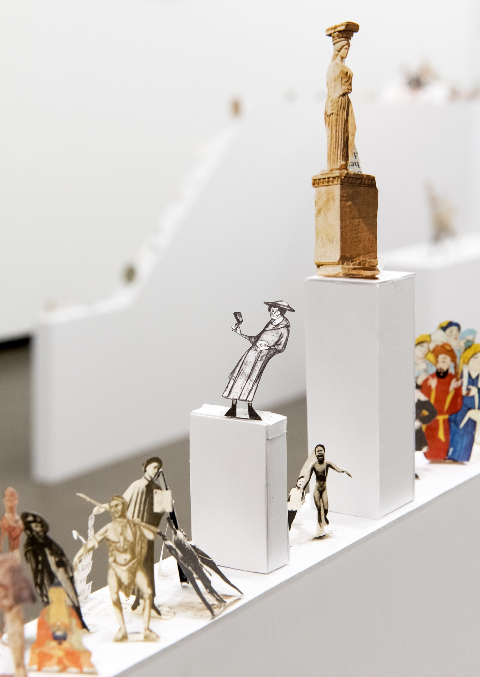 Geoffrey Farmer, The Last Two Million Years, 2007, foamcore plinths, perspex frames and cutouts from selected pages of the history book The Last Two Million Years, dimensions variable. Installation view, How Do I Fit This Ghost in My Mouth?, Vancouver Art Gallery, 2015