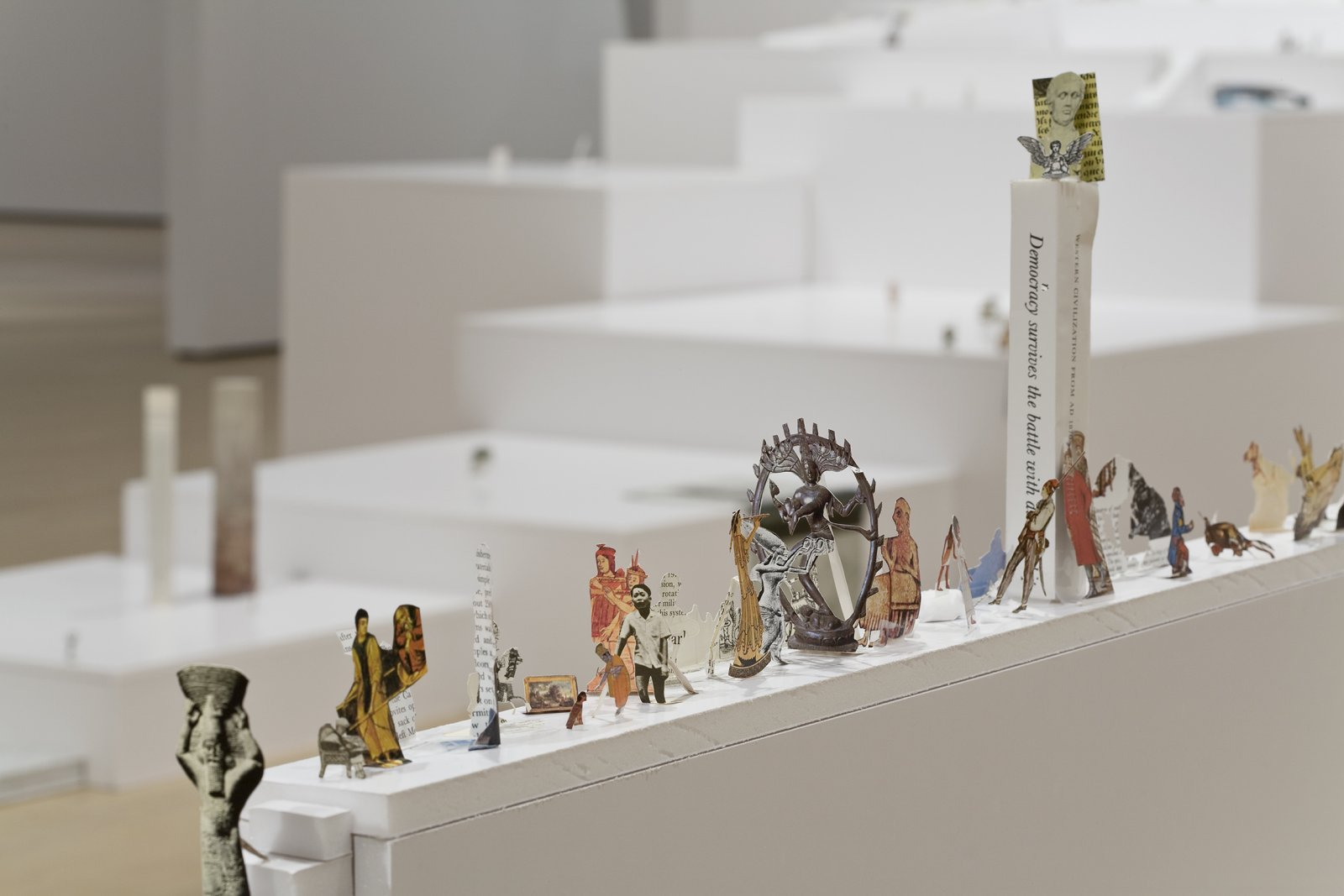 Geoffrey Farmer, The Last Two Million Years, 2007, foamcore plinths, perspex frames and cutouts from selected pages of the history book The Last Two Million Years, dimensions variable. Installation view, Musée d'art contemporain de Montréal, 2008
