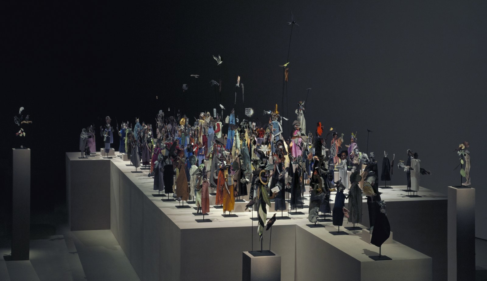 Geoffrey Farmer,The Surgeon and the Photographer, 2009, paper, textile, wood, and metal, 365 figures, dimensions variable. Installation view,Barbican Centre, London, 2013