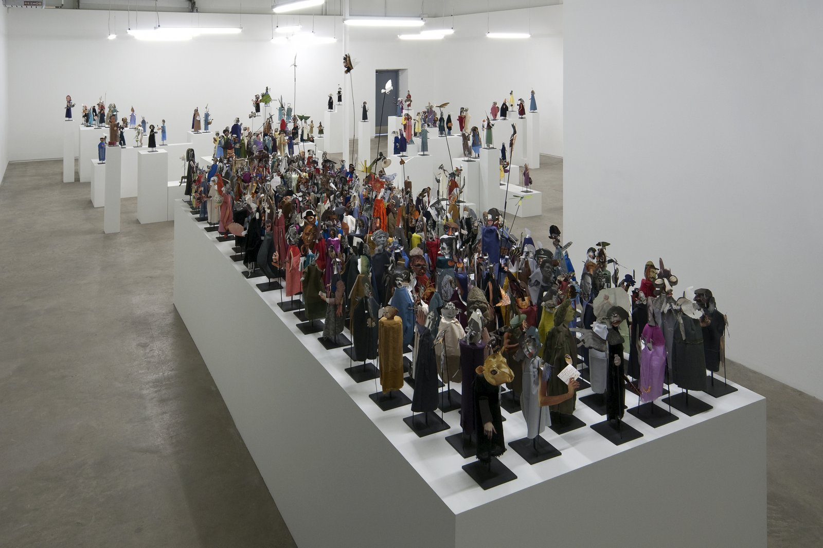 Geoffrey Farmer,The Surgeon and the Photographer, 2009, paper, textile, wood, metal, 365 figures, each figure approximately 18 x 5 x 5 in. (45 x 13 x 13 cm). Installation view, Catriona Jeffries, 2010