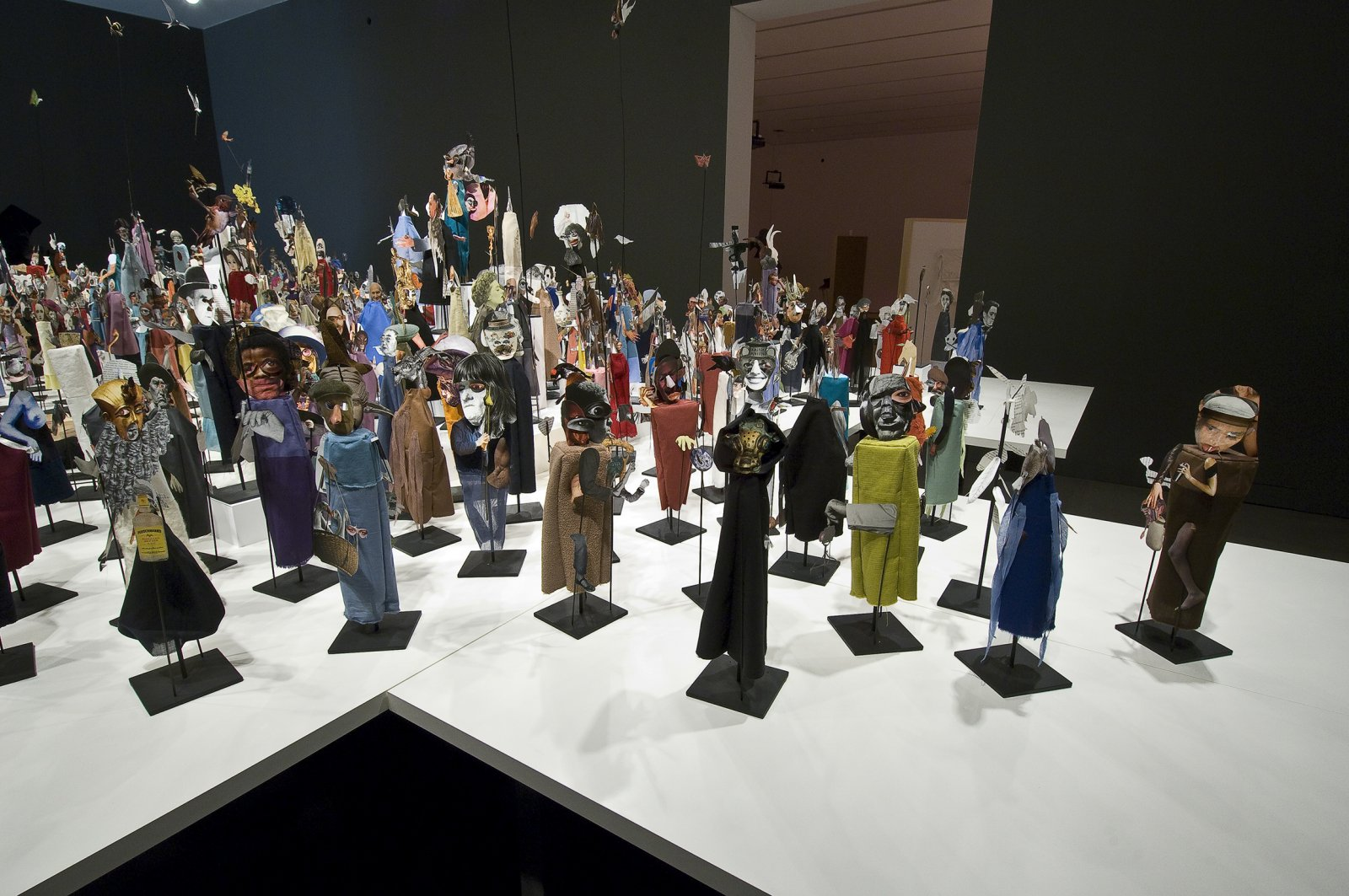Geoffrey Farmer,The Surgeon and the Photographer, 2009, paper, textile, wood, and metal, 365 figures, dimensions variable. Installation view,Nomads, National Gallery of Canada, Toronto, 2009