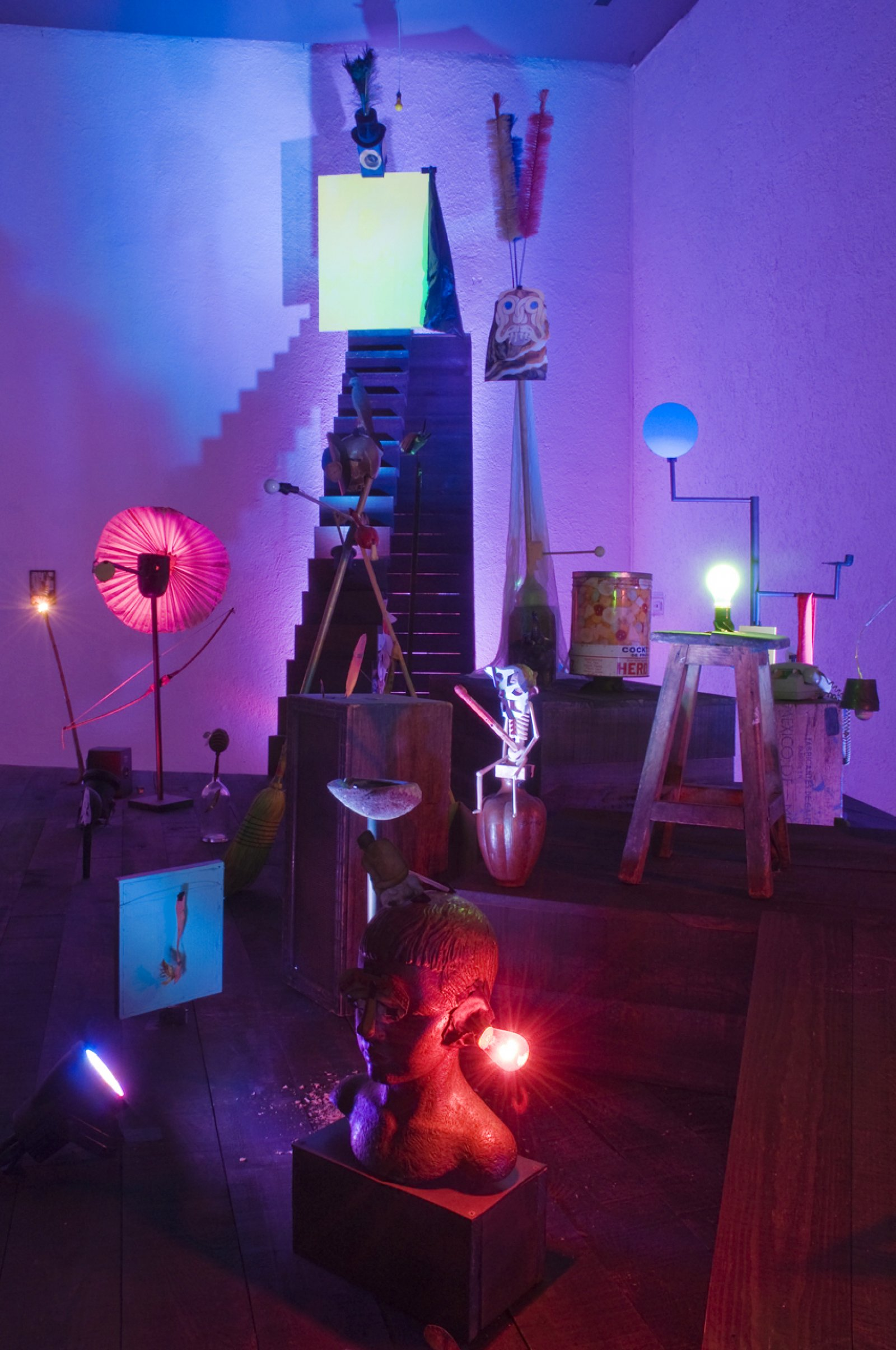Geoffrey Farmer,The Vampire of Coyoacan, 2010, sculptural objects, sound and light installation on raised platform, various mixed media, mac mini, entec dmx box, fire box sound interface, servo motors, LED lights, speakers for 6 channels of sound, amplifier, dimensions variable. Installation view,The Vampire of Coyoacán and His Twenty Achichintles, El Eco, Mexico City, 2010