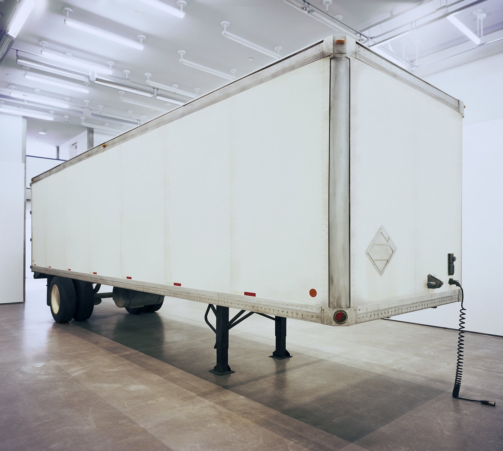Geoffrey Farmer, Trailer, 2002, steel, fiberboard, mixed media, 134 x 87 x 354 in. (340 x 220 x 900 cm). Installation view, The Blacking Factory, Contemporary Art Gallery, Vancouver, 2002 by Geoffrey Farmer