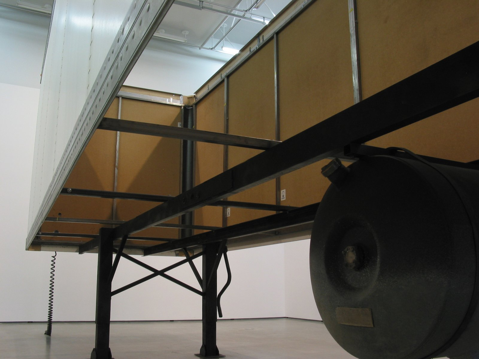 ​Geoffrey Farmer, Trailer, 2002, steel, fiberboard, mixed media, 134 x 87 x 354 in. (340 x 220 x 900 cm). Installation view, The Blacking Factory, Contemporary Art Gallery, Vancouver, 2002​ by Geoffrey Farmer