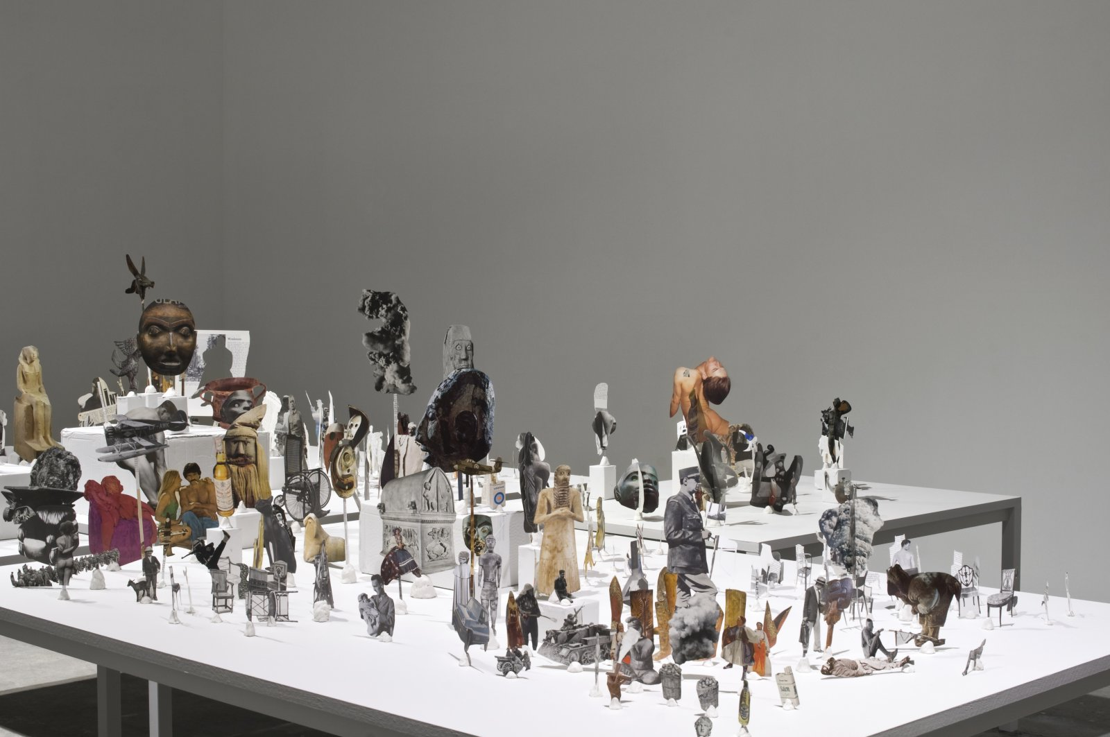 Geoffrey Farmer, Untitled (Standing Image Archive), 2011, approximately 500 magazine cut-outs with stands upon five tables, fireplace, broom, dimensions variable. Installation view, Untitled (12th Istanbul Biennial), Istanbul, 2011 by Geoffrey Farmer