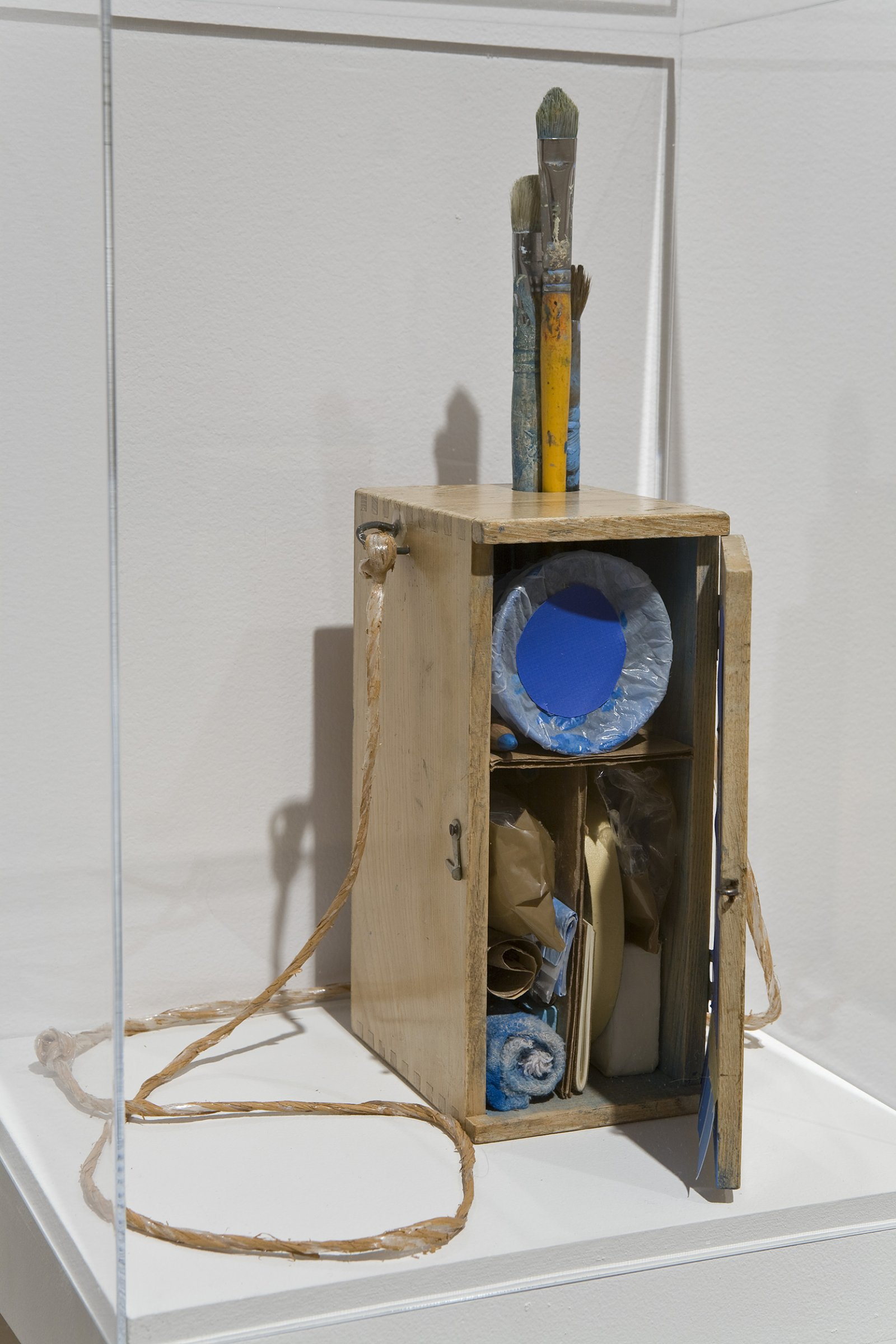 Geoffrey Farmer,Void Numbering Project (continuous), 1992, wooden box containing various materials such as paint, paintbrushes, masking tape and shelf with plexiglass top, dimensions variable