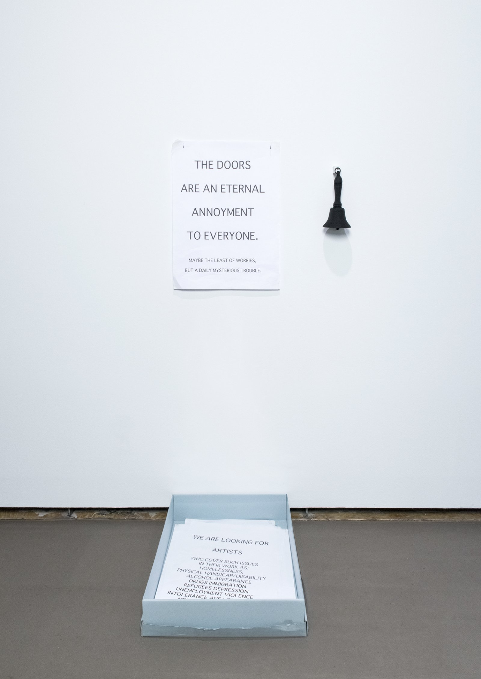 Geoffrey Farmer, Whose work are we doing?, 2007, 25 posters, brass bell painted black, hook, archival box, dimensions variable
