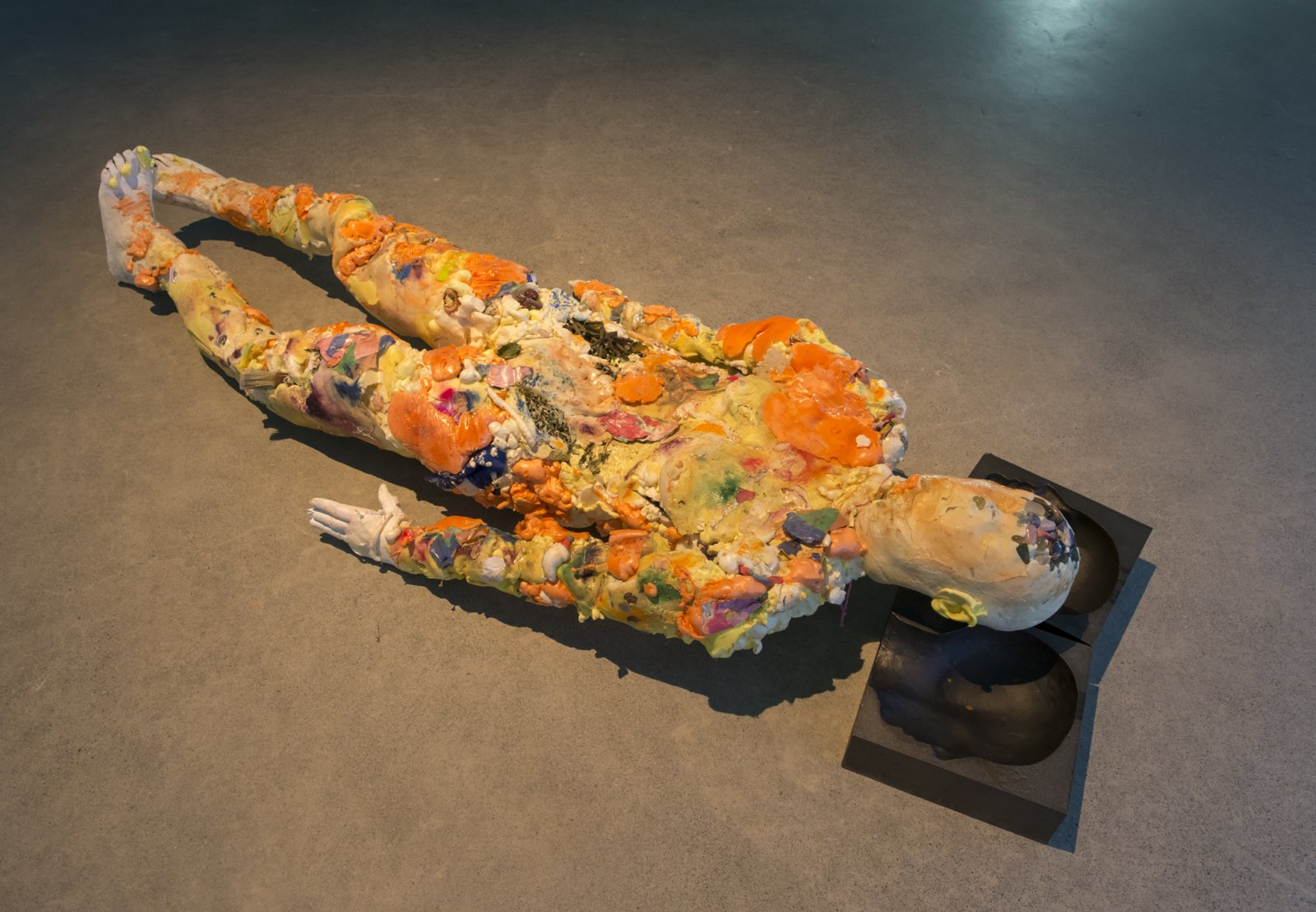 Julia Feyrer, Corpse, Maiden, 2018, insulation foam, whistle, glass marbles, mineral rocks, broken rulers, coins, lenses, blackberry, mugwort, rope, hinges, gummy worms, plaster cast hands and feet, soil, aluminum armature, latex, pigment, paper, cast iron, miscellaneous materials, 71 x 28 x 13 in. (180 x 71 x 33 cm)