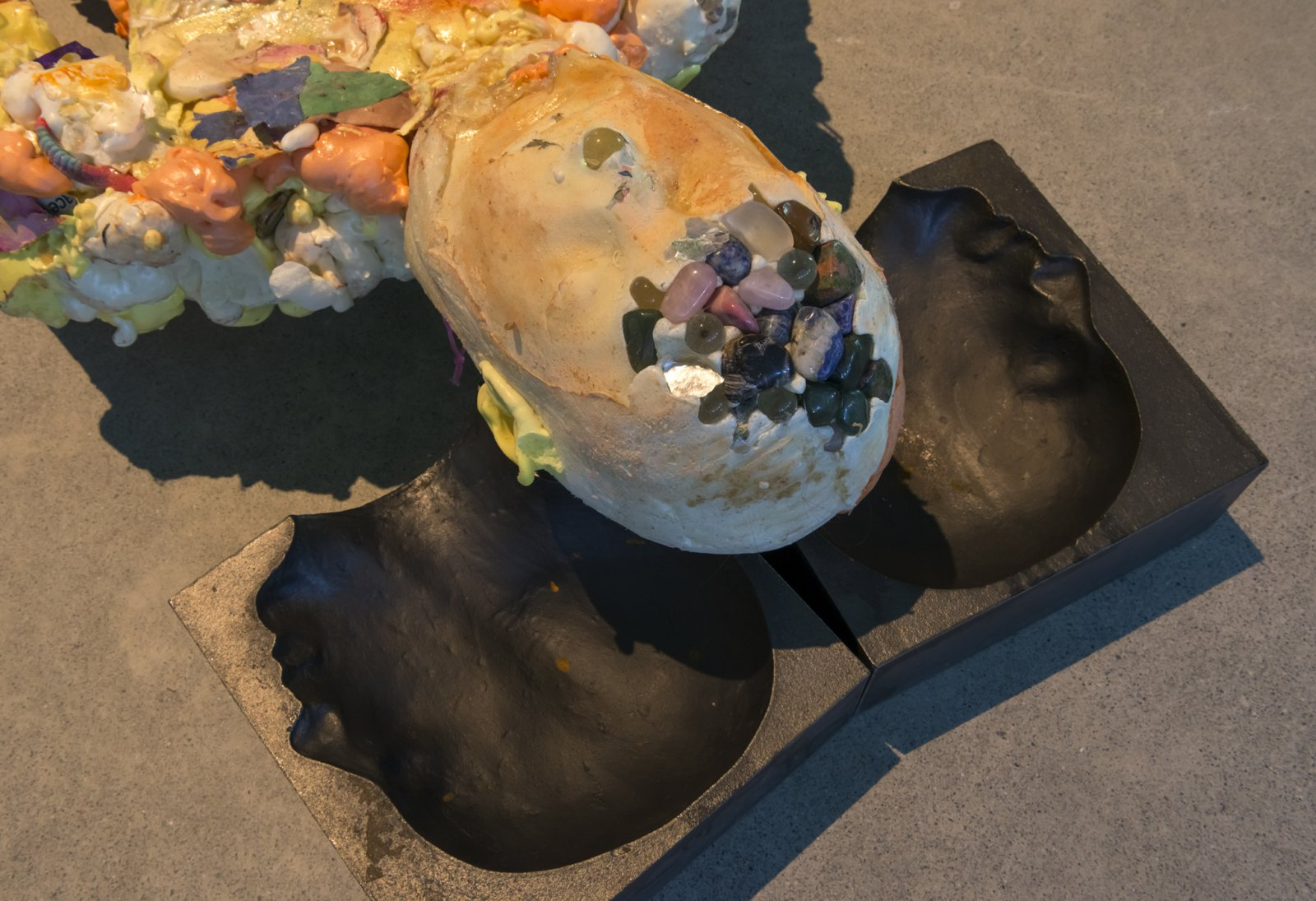 Julia Feyrer, Corpse, Maiden (detail), 2018, insulation foam, whistle, glass marbles, mineral rocks, broken rulers, coins, lenses, blackberry, mugwort, rope, hinges, gummy worms, plaster cast hands and feet, soil, aluminum armature, latex, pigment, paper, cast iron, miscellaneous materials, 71 x 28 x 13 in. (180 x 71 x 33 cm)