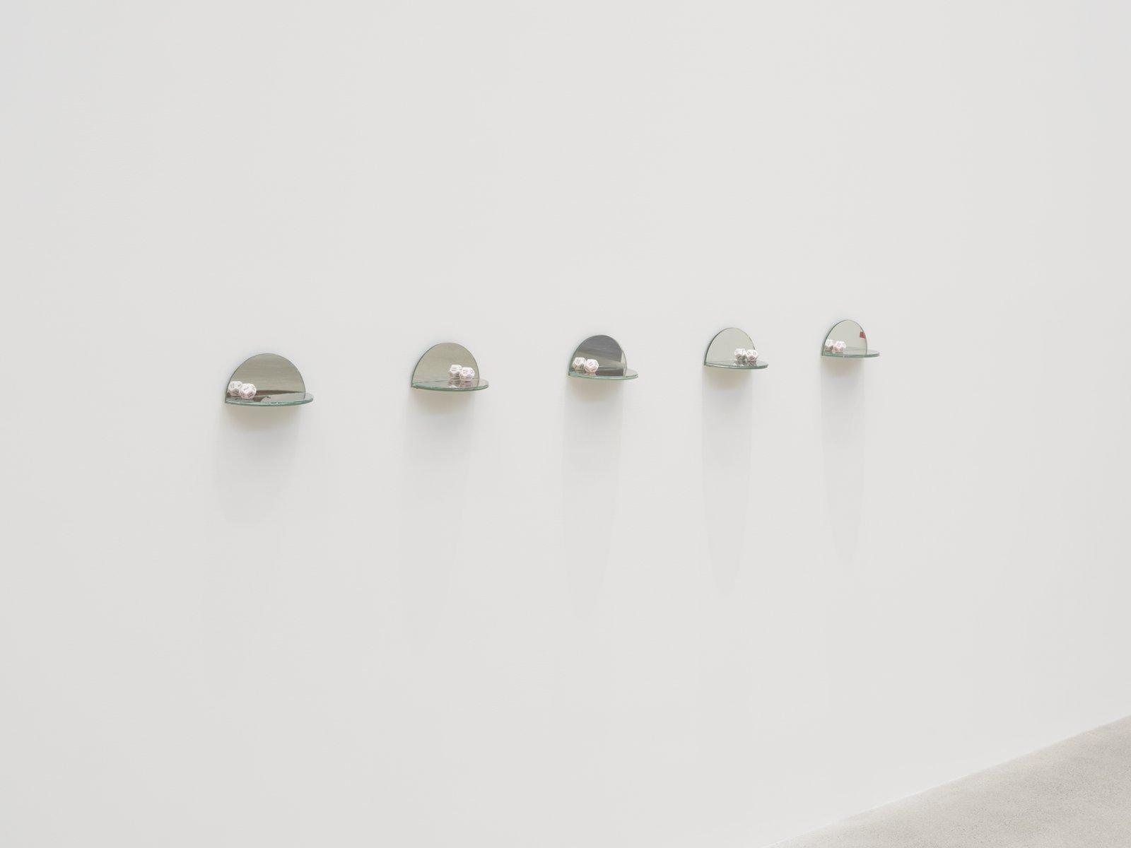 Julia Feyrer, The Ambidextrous Universe, 2018, mirror, liquid mirror, glass, fujiclear transparency, 12-sided die, each 4 x 4 x 7 in. (9 x 9 x 18 cm)