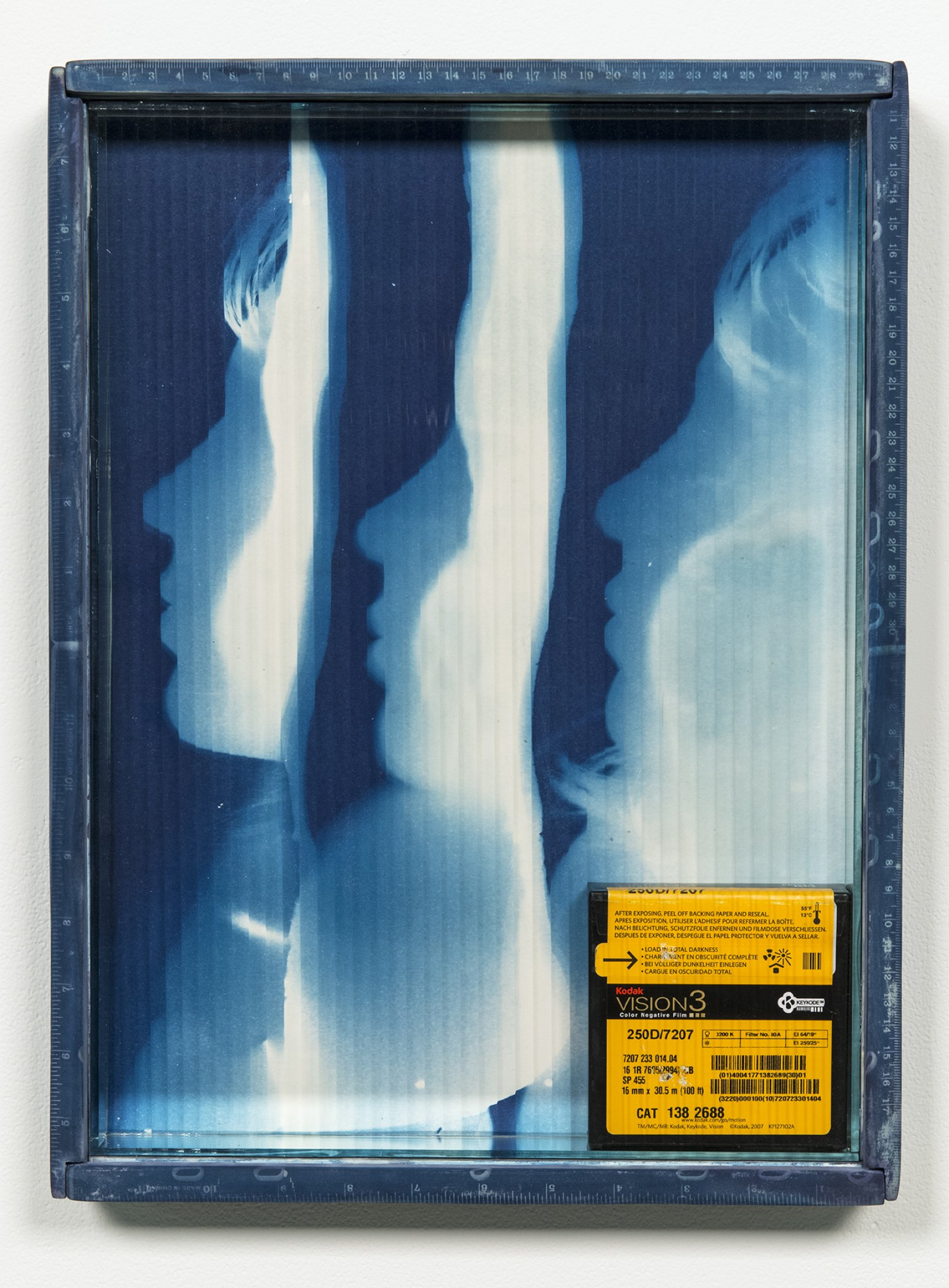 Julia Feyrer, Vision3, 2012, cyanotype treated pine wood frame, cyanotype on watercolour paper, mirror inset, quarter reed architectural glass, 16mm vision3 kodak 100ft film canister, 17 x 13 in. (43 x 32 cm)