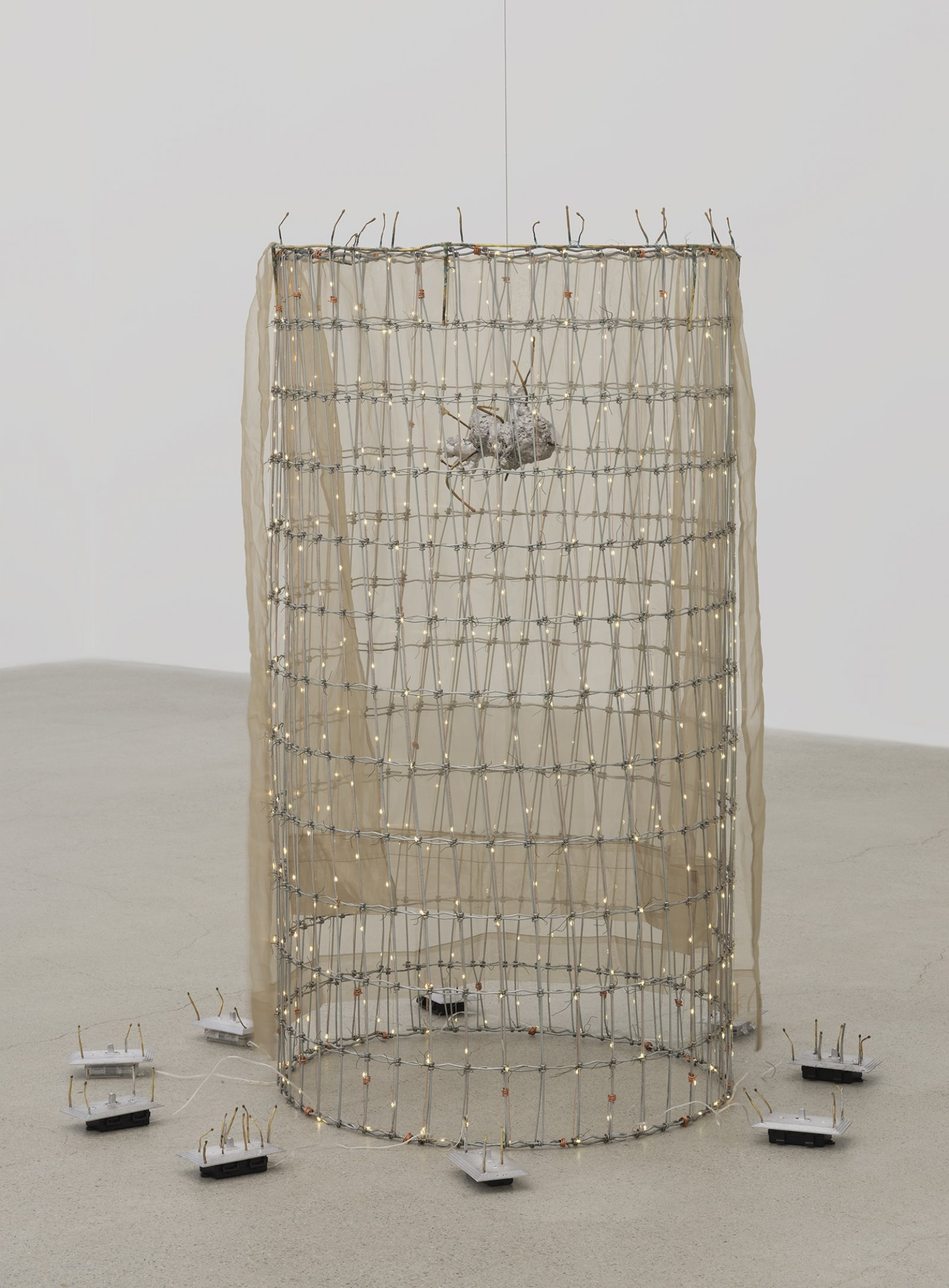 Rochelle Goldberg, Trigger: Towards everything they've ever wanted, 2019, ranch fencing, batteries, fairy lights, polyester curtain, aluminum, cast bronze matches, copper wire, 51 x 51 x 44 in. (130 x 130 x 112 cm) by Rochelle Goldberg