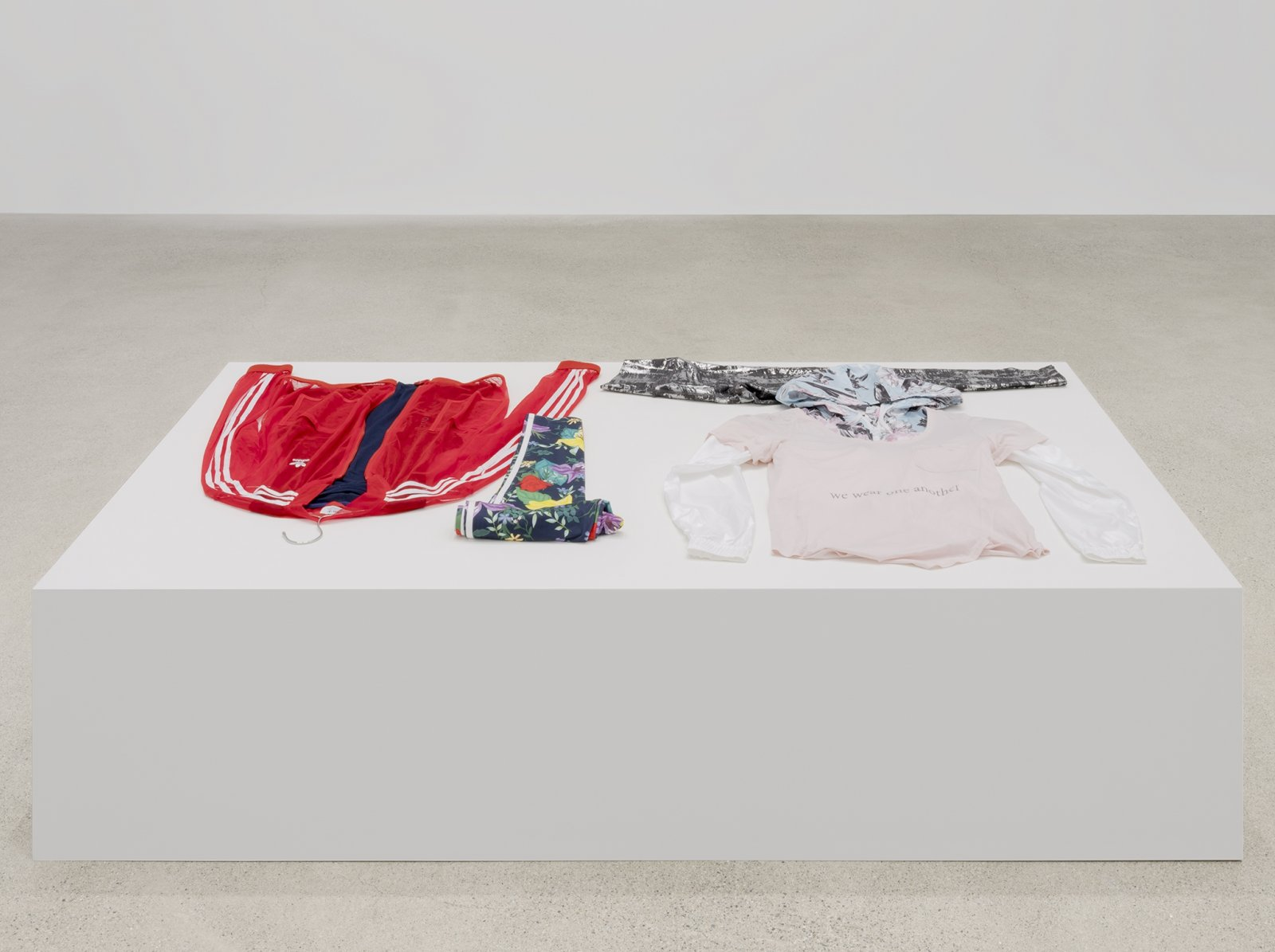 Tanya Lukin Linklater, Attire for performance, We wear one another, 2019, clothing, silkscreen, 18 x 71 x 41 in. (46 x 180 x 104 cm)