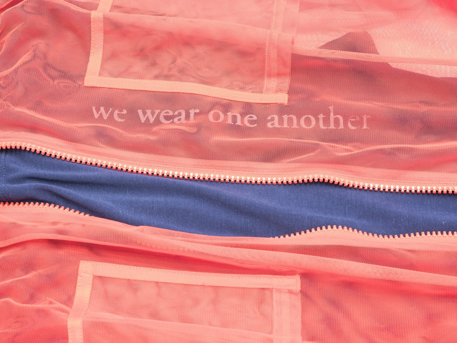 Tanya Lukin Linklater, Attire for performance, We wear one another (detail), 2019, clothing, silkscreen, 18 x 71 x 41 in. (46 x 180 x 104 cm)
