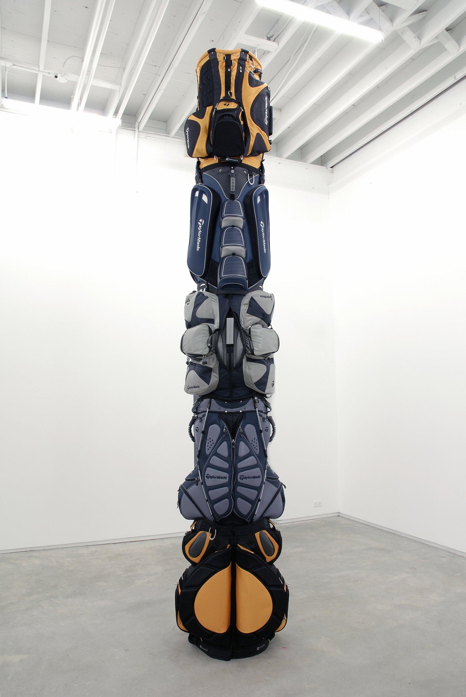 Brian Jungen, 1970, 2007, golf bags, cardboard tube, 151 x 30 x 35 in. (384 x 76 x 89 cm)   by Brian Jungen