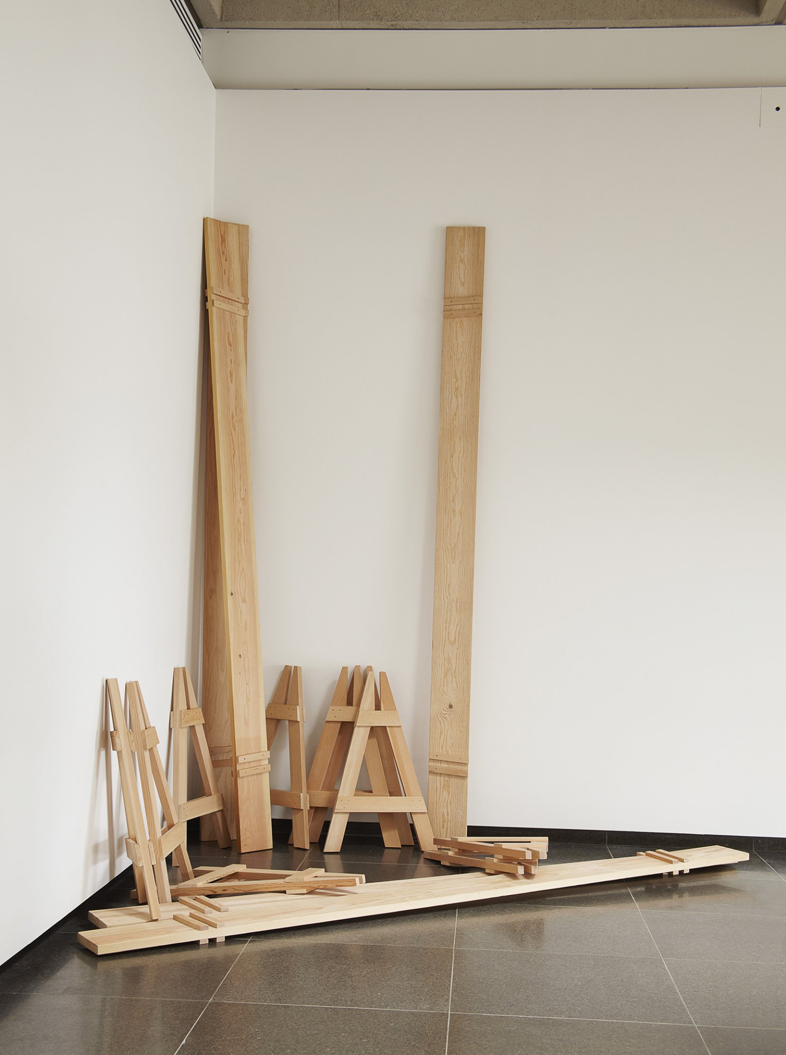 Brian Jungen,Barricades, 2010, fir, each 41 x 26 x 144 in. (104 x 66 x 366 cm).Installation view,Tomorrow, Repeated, Art Gallery of Ontario, Toronto, 2011