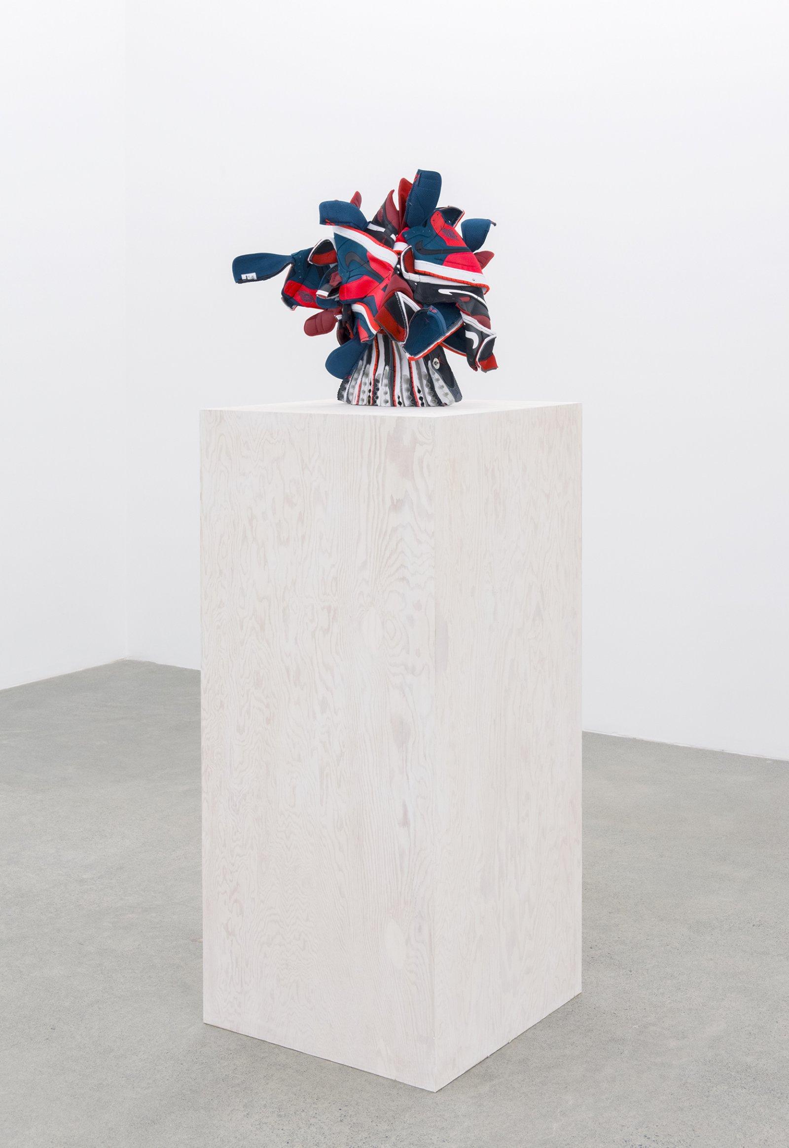 Brian Jungen, Broken Arrangement, 2015–2016, nike air jordans, painted fir plywood, stainless steel, 75 x 24 x 24 in. (191 x 61 x 61 cm) by Brian Jungen