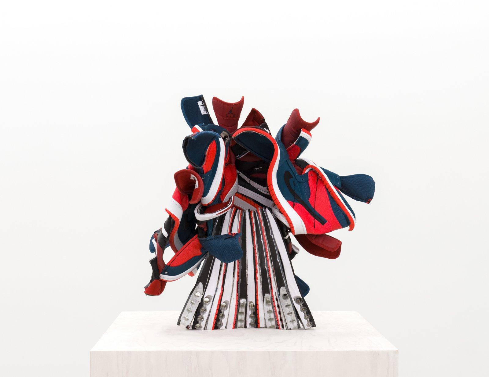 Brian Jungen, Broken Arrangement (detail), 2015–2016, nike air jordans, painted fir plywood, stainless steel, 75 x 24 x 24 in. (191 x 61 x 61 cm) by Brian Jungen