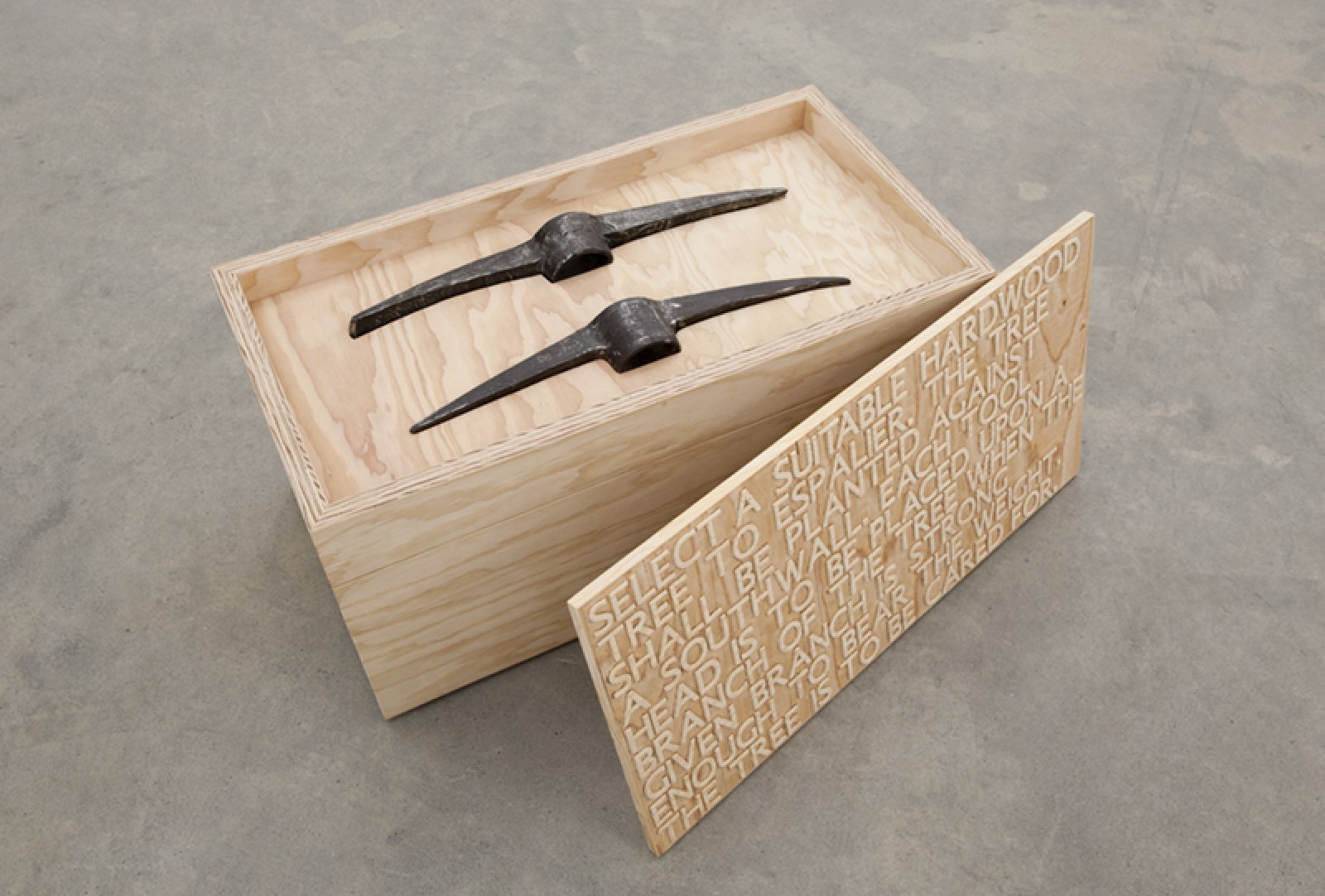 Brian Jungen,Bushido, 2012,fir plywood, axe heads, tree, book,16 x 31 x 16 in. (41 x 79 x 41 cm)