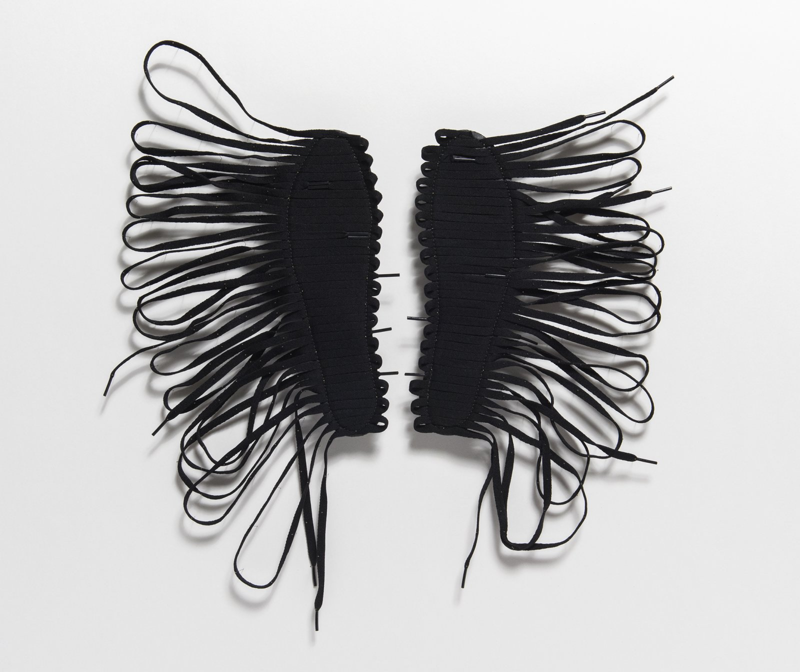 Brian Jungen,Cassius, 2016, air jordan insoles, shoelaces, insect pins, 31 x 31 x 1 in. (81 x 81 x 3 cm). Courtesy Casey Kaplan, New York