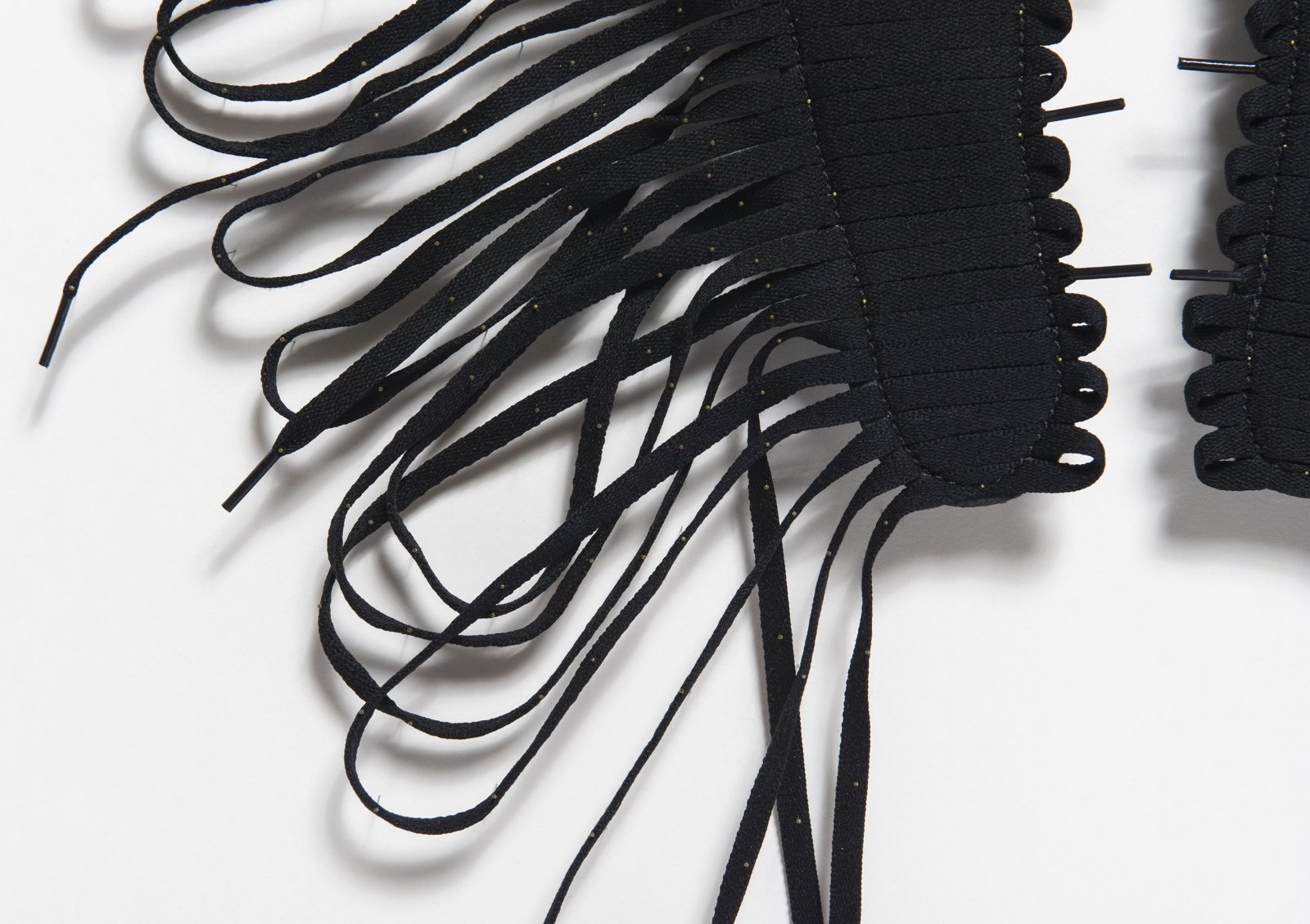 Brian Jungen,Cassius(detail), 2016, air jordan insoles, shoelaces, insect pins, 31 x 31 x 1 in. (81 x 81 x 3 cm). Courtesy Casey Kaplan, New York