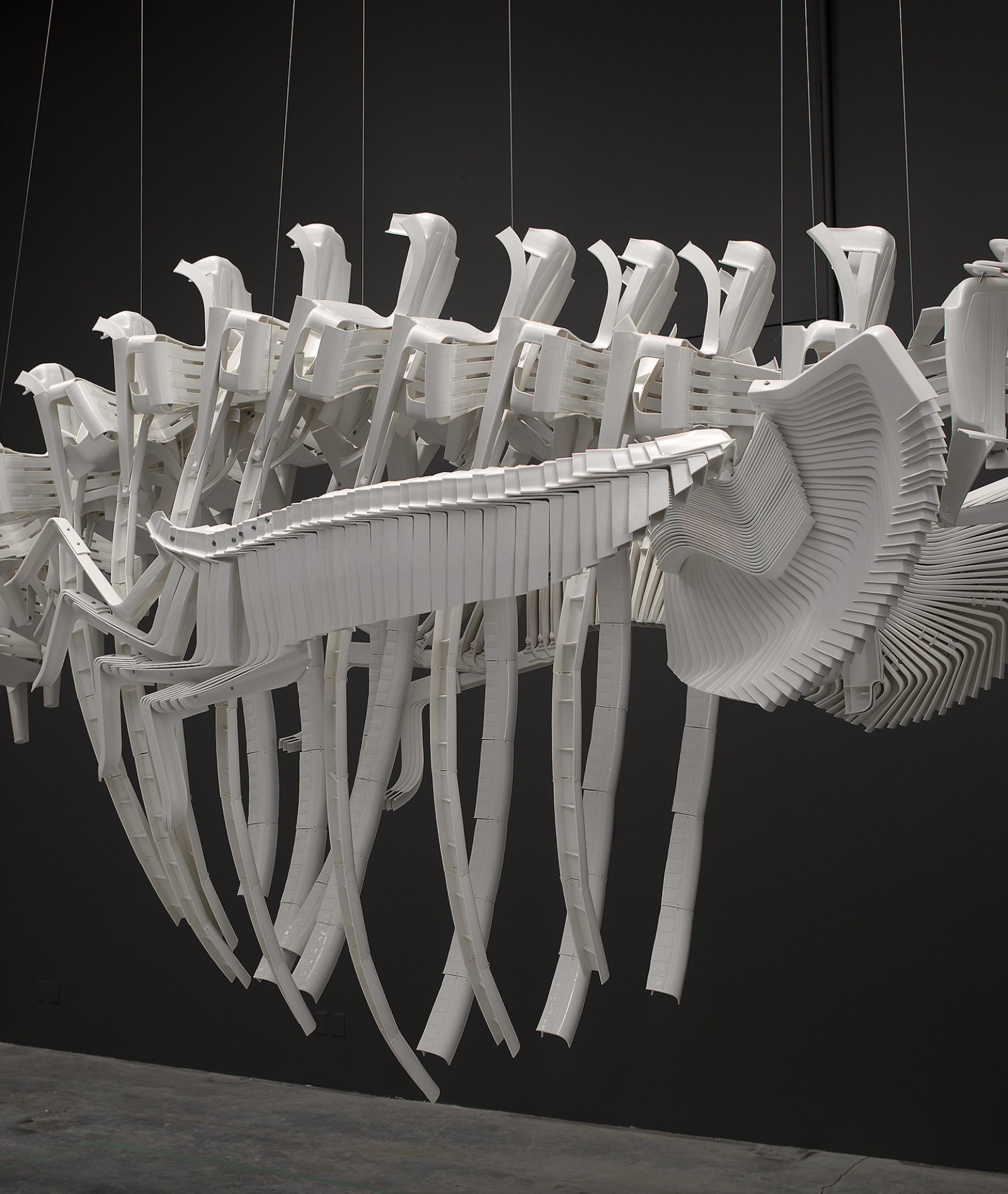 Brian Jungen,Cetology(detail), 2002, plastic chairs, 159 x 166 x 587 in. (404 x 422 x 1491 cm)