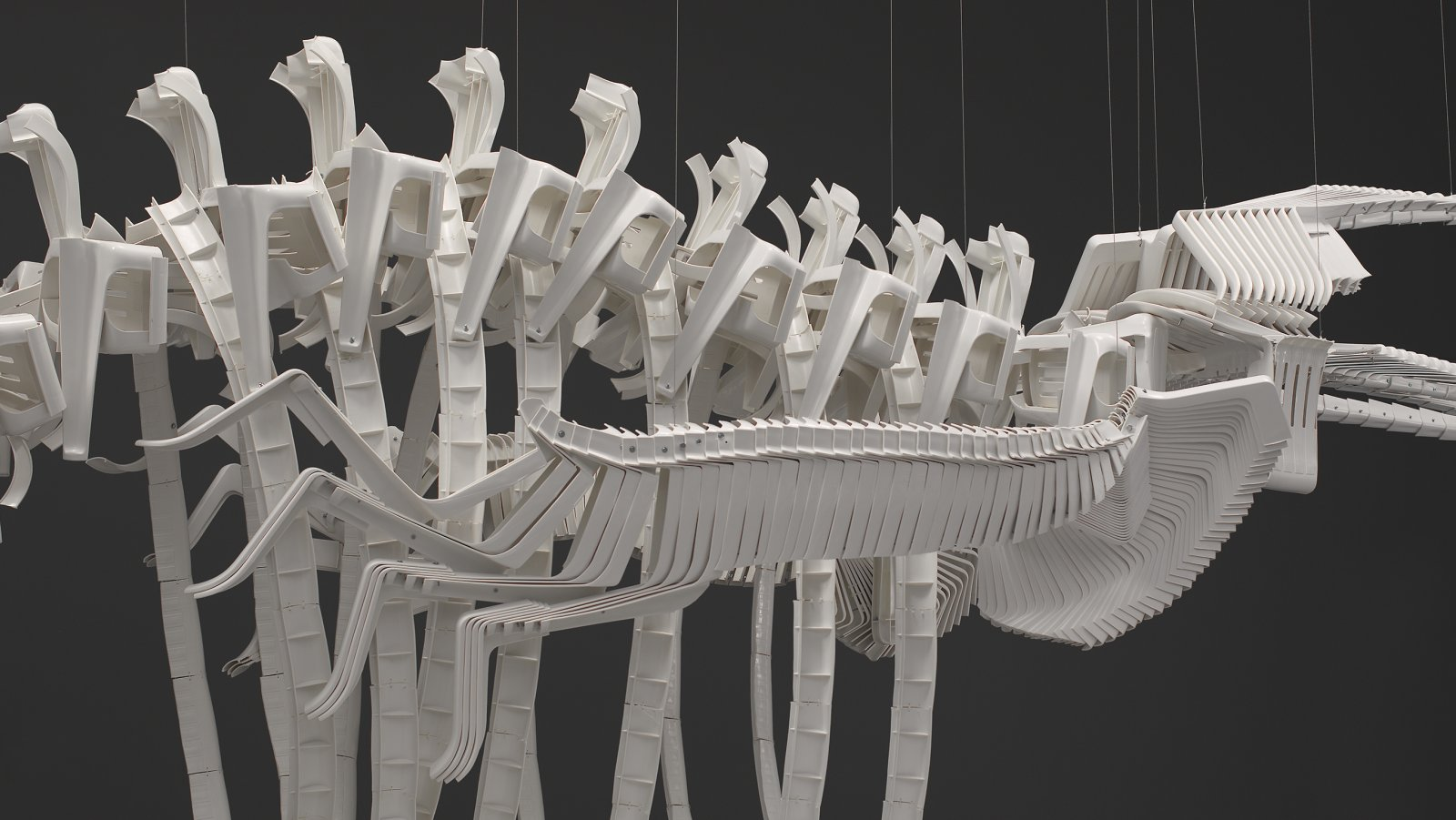 Brian Jungen,Cetology (detail), 2002, plastic chairs, 159 x 166 x 587 in. (404 x 422 x 1491 cm)
