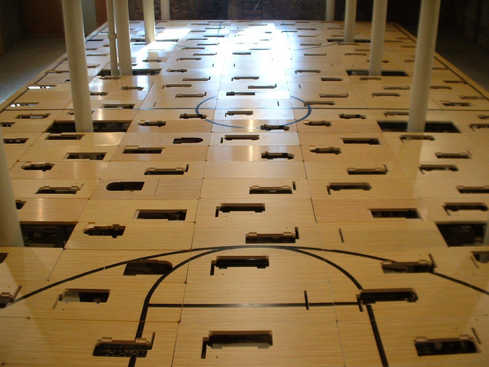 Brian Jungen,Court, 2004,224 sweatshop tables, paint, 2 rolling steel warehouse ladders, 2 basketball hoops each with net and backboard, 148 x 336 x 840 in. (376 x 853 x 2134 cm)